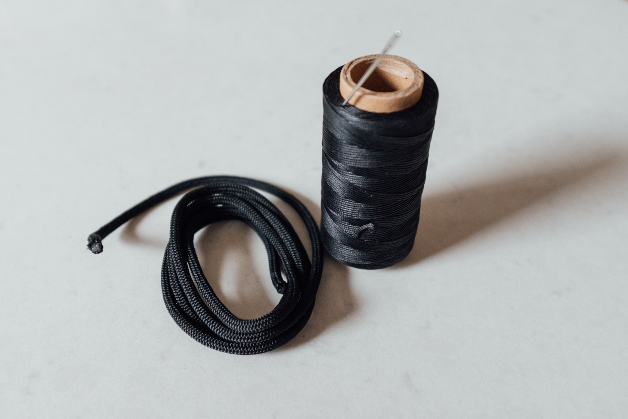 Wax thread, simple climbing line and a big needle is pretty much all you need.