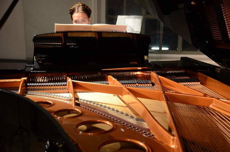 Chanda VanderHart behind piano strings
