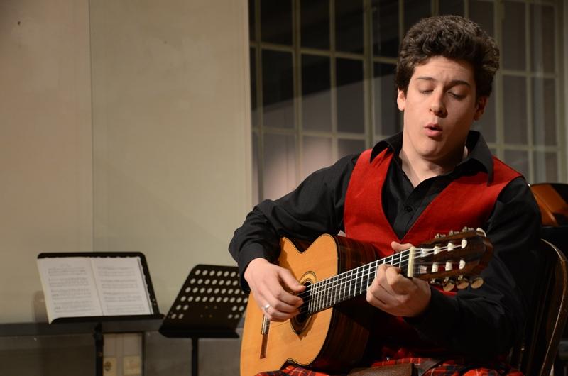 Bryan Benner serenades with guitar