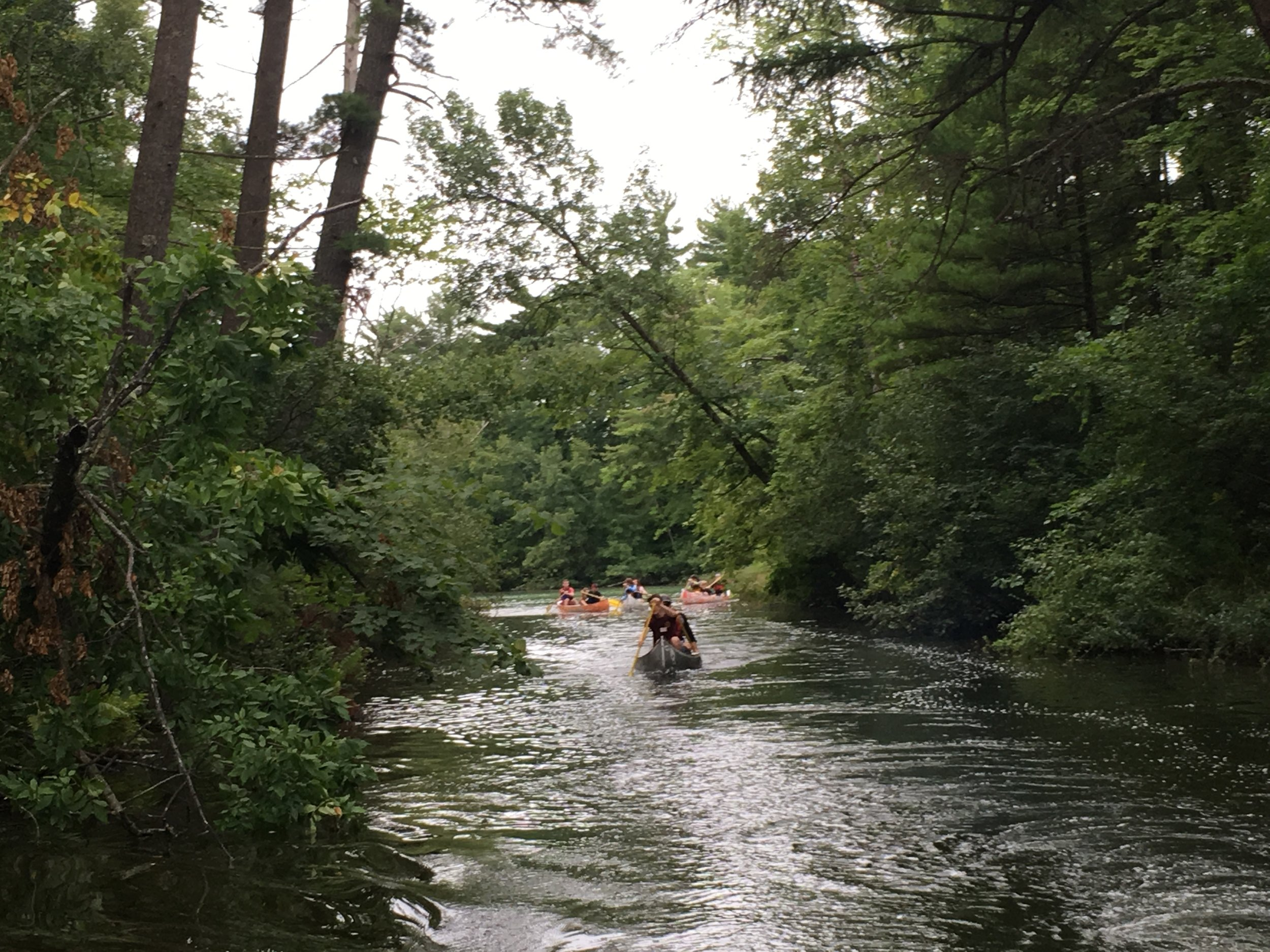 Campers heading down the Crystal River on one of many Onaway Adventure Camp Canoe Trips.