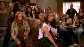 Potential slayers listen to Buffy's plan to share her power with all of them.
