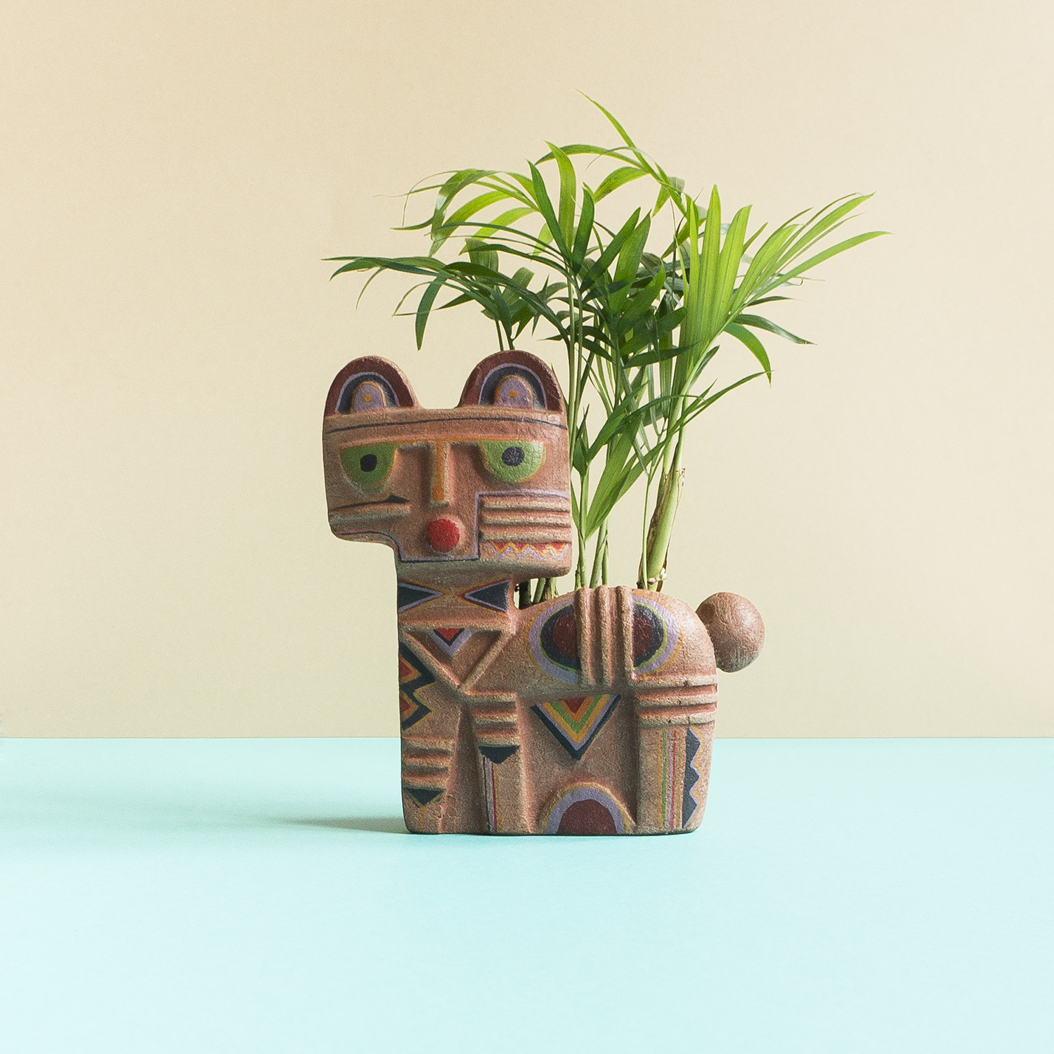 Acid Cat. A mystery purpose cat with a small pot attached on his backside. Mexican ashtray? Nightmare catcher? Pot planter? Who knows.
