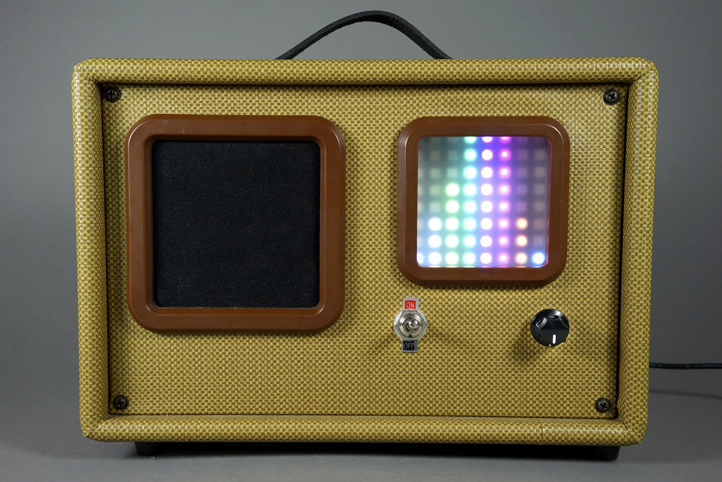 Samuel's reproduction-radio-turned amplifier with bluetooth and music visualizer.