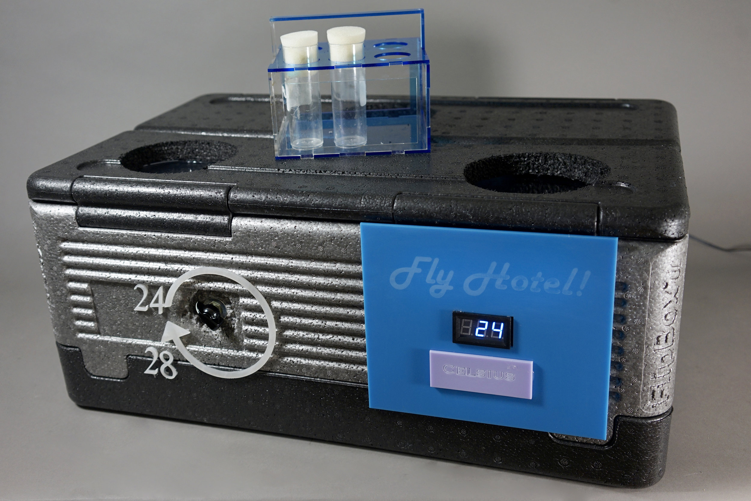 This is a fly incubator, created for our genetics instructor, by a group of four 9th grade students. With custom-made incubation tube caddies, this container keeps the fly larvae (also known as maggots : 0) in an adjustable, temperature-regulated environment. This was created by Alex, Indigo, Max and Kaira.