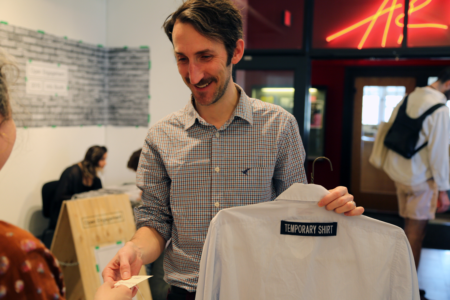 Participants are offered a temporary shirt to wear whilst their garment is being worked on