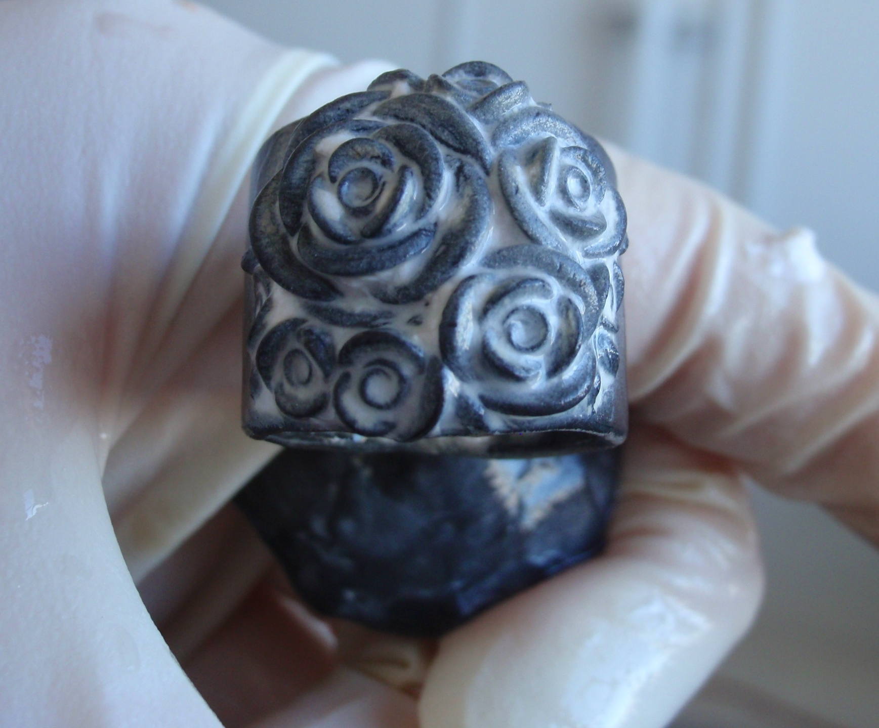 A freshly cast ring with several roses, before any cleaning.