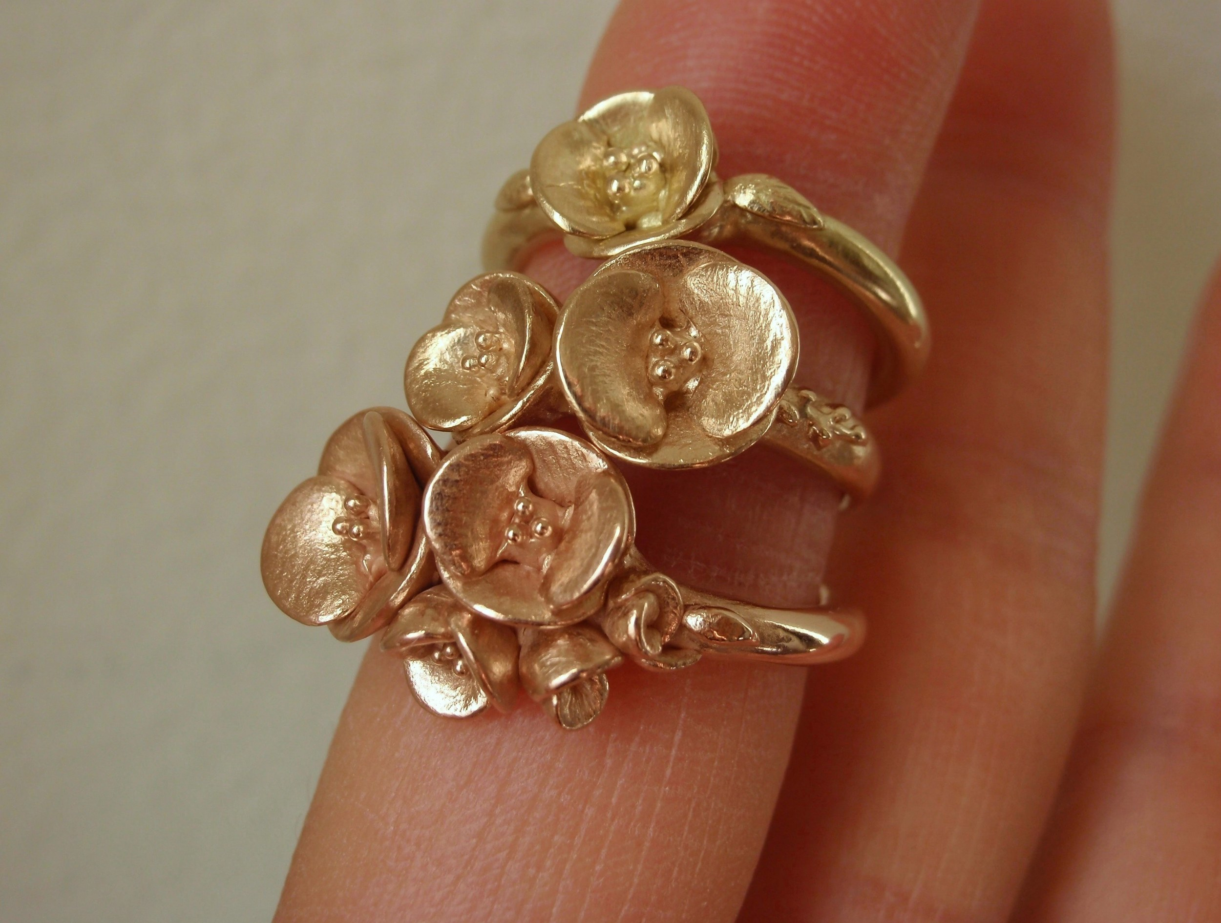Poppy Rings in 14K Rose, Peach, and Yellow Gold.