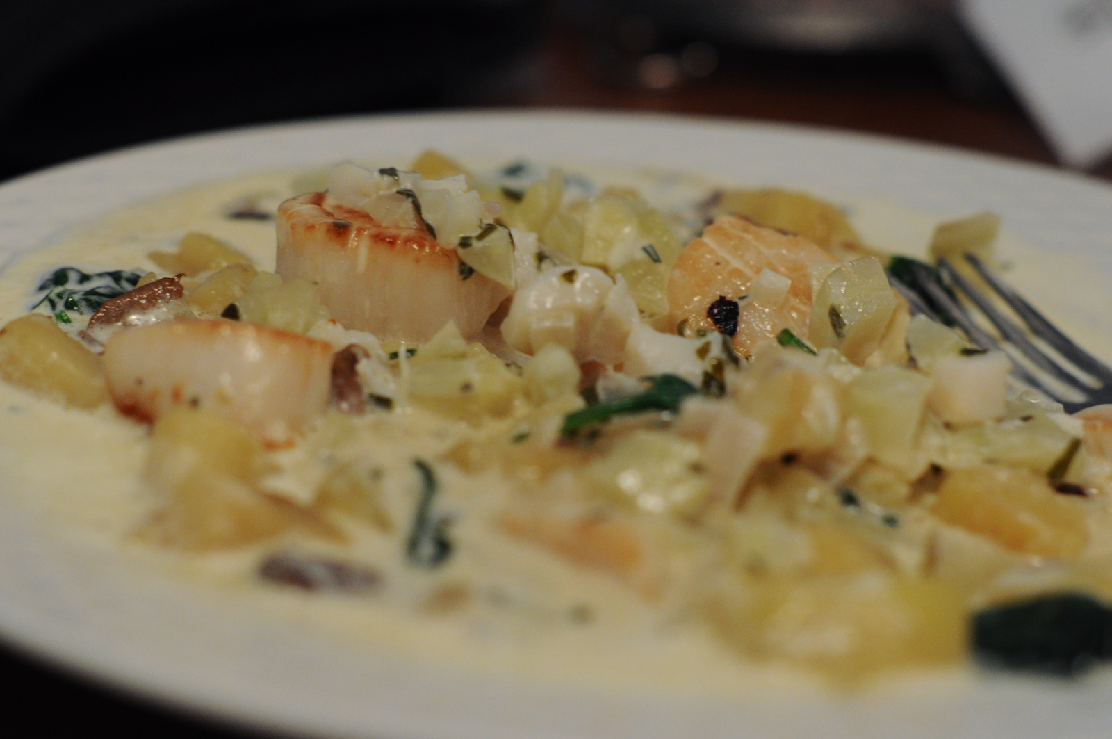 Pan-seared sea scallops in a cream sauce on top of risotto