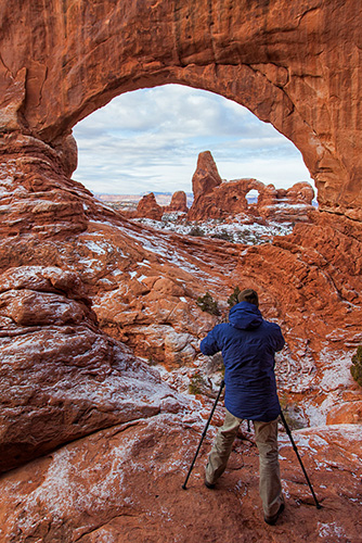 Photographer on private workshop at North Window in Arches National Park, Utah