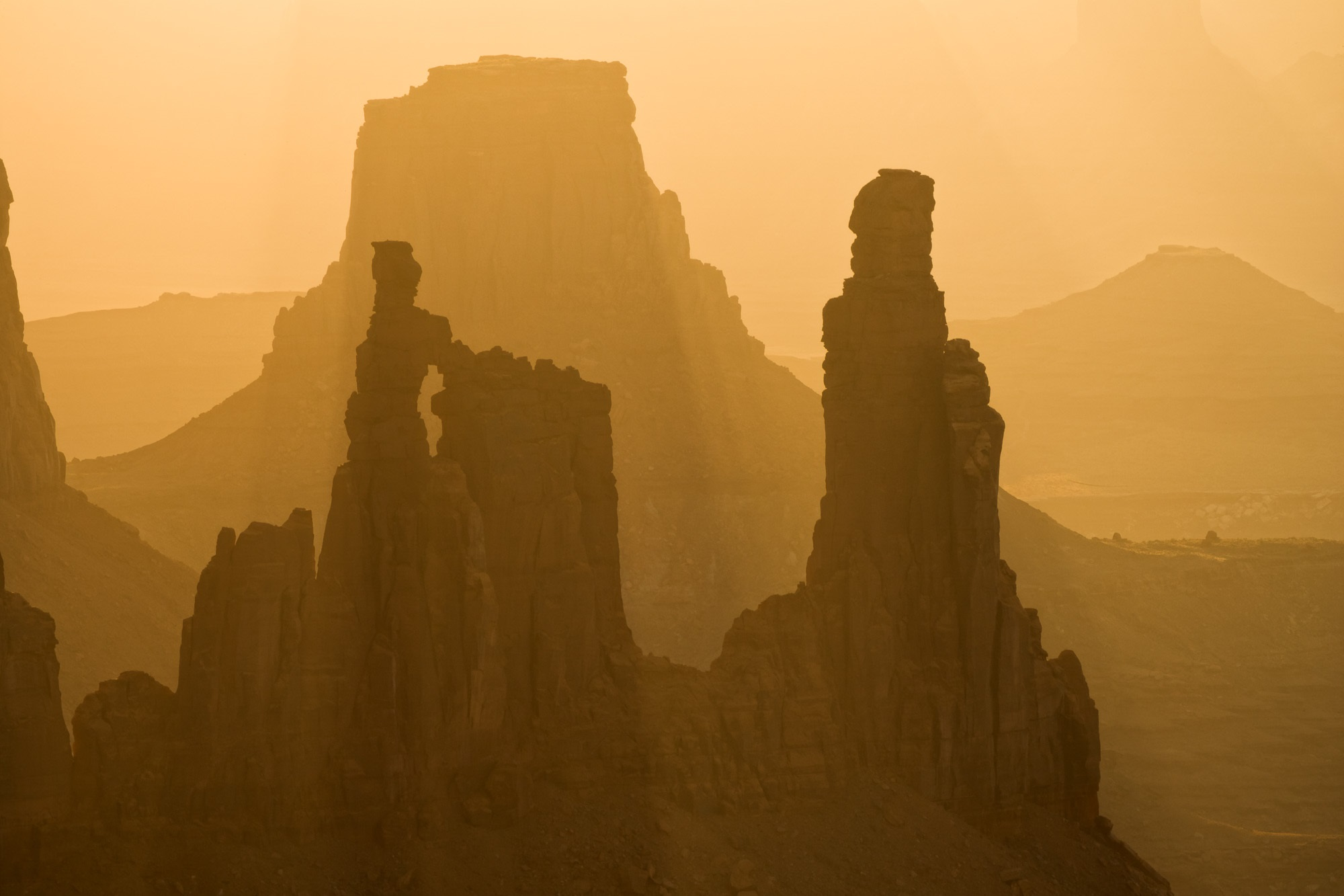 Washer Woman Arch and Monster Tower at Sunrise, Canyonlands National Park, Utah