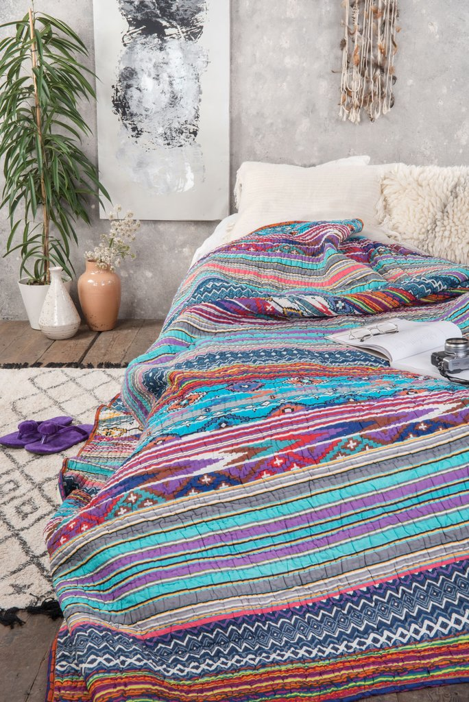https://www.iansnow.com/collections/quilts/products/purple-and-teal-stripe-gudari-quilt