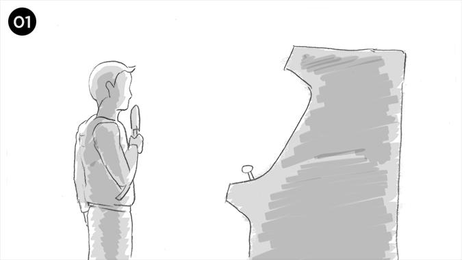 Un niño de unos 11 años se acerca a una maquina arcade en un salón de juegos
