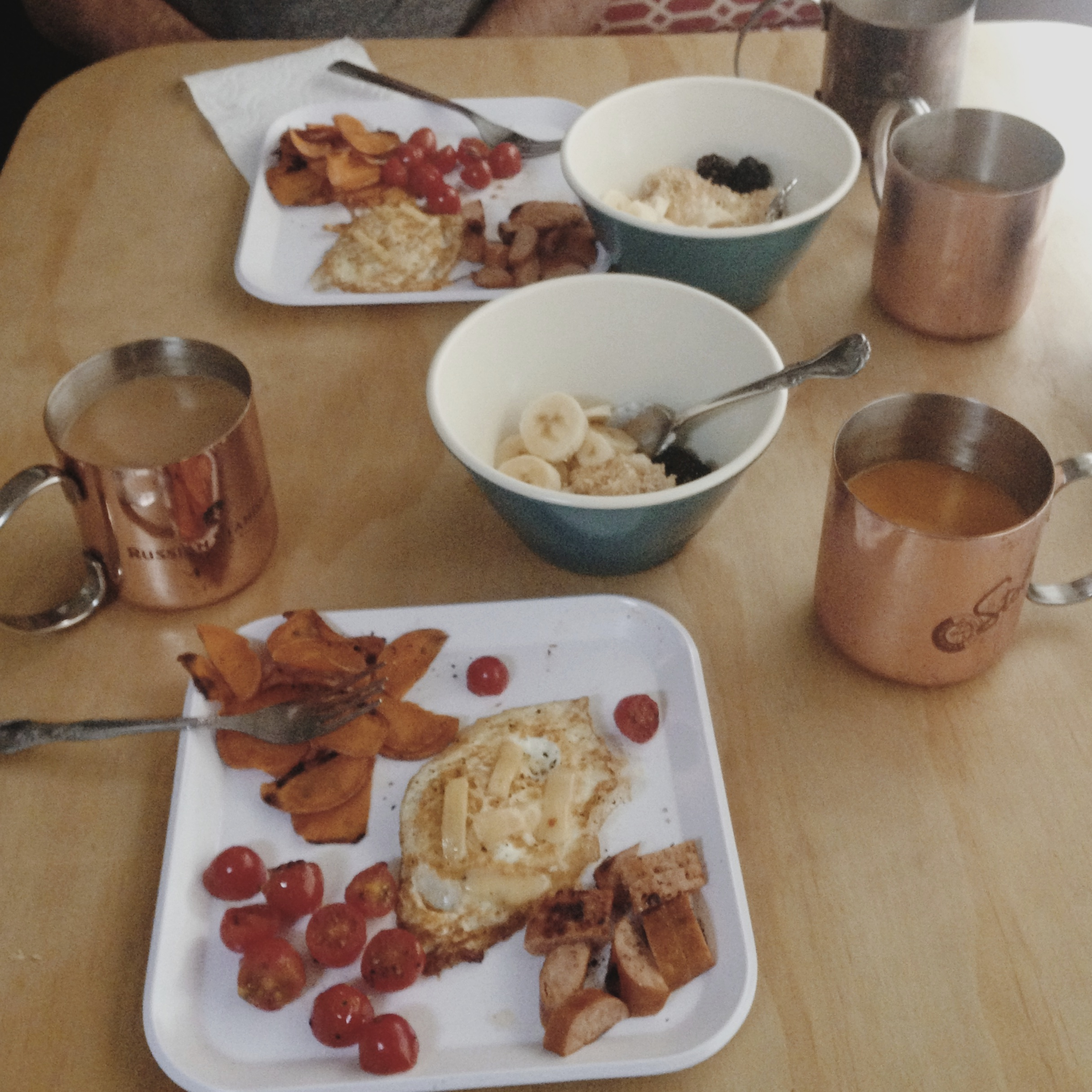 Breakfast  in the Dolphin.  Coffee, of course, OJ, steel cut outs with fruit, eggs and what looks like leftovers (sausage, sweet potato home fries and tomatoes).
