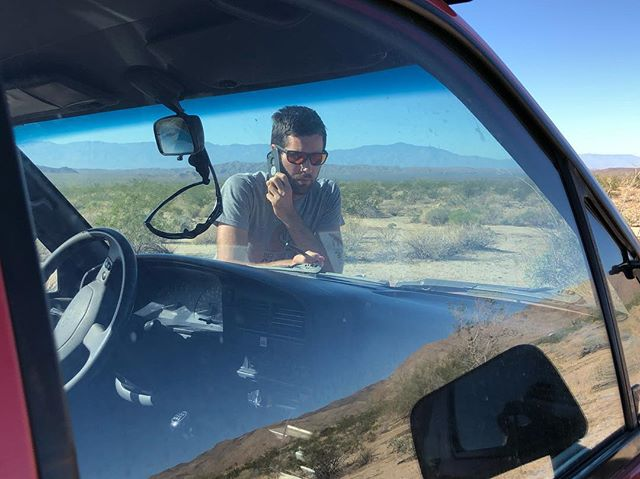 Cameron taking his biz calls from the desert . #getloststaycharged #offgrid #offthegrid #remotework #analognomad #rvlife #smallbusiness #offthegridcamper