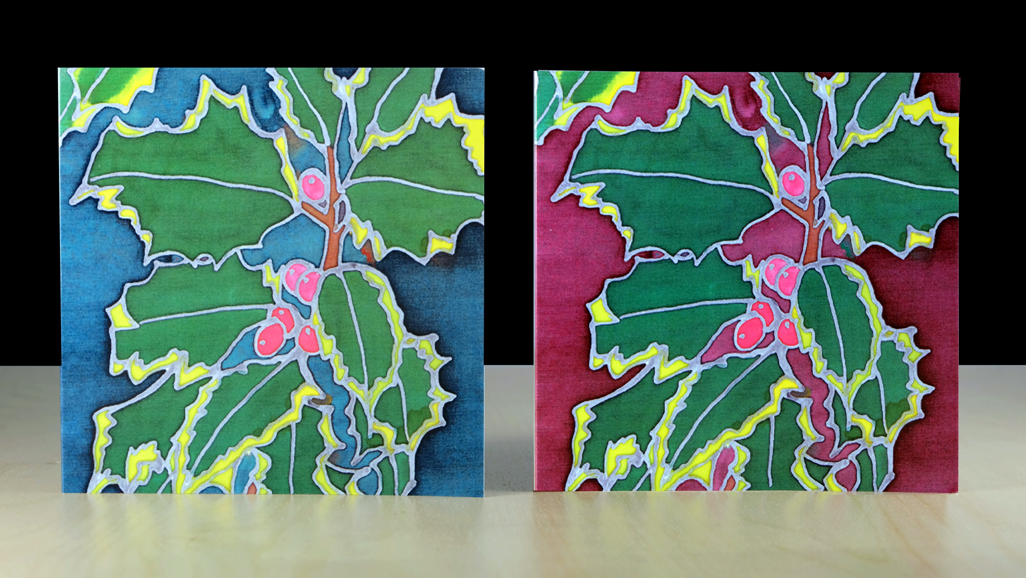 A pack of 6 quality Christmas Holly greeting cards and envelopes.   Message: Merry Christmas and a Happy New Year  Featuring original silk painted illustrations by  Sherren  McCabe-Finlayson. Other non-seasonal illustrations available include Autumn Leaves, Cow Parsley, Tulips and 'After Klimt'. These cards are perfect for quick notes, or birthday wishes  for  anyone who loves nature. You can find them all in our shop.  Printed on quality card, gloss laminated and supplied as a set of 3 red and 3 green holly in a cellophane bag, with white envelopes.  Dimensions: 13.5cm x 13.5.  Proudly designed and printed in Wales.