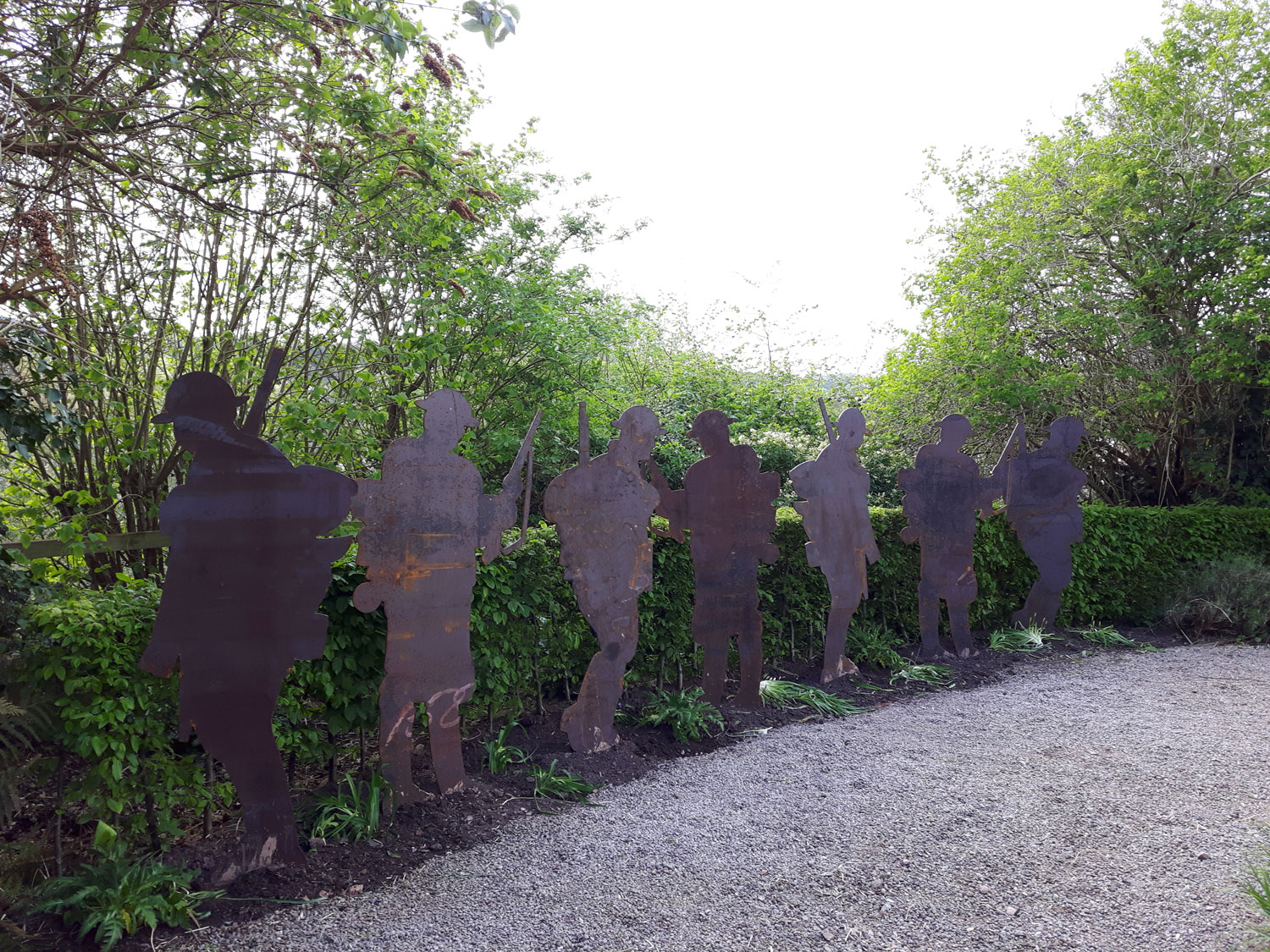 7 life-size steel soldiers stand as a poignant tribute in the Royal Monmouthshire Royal Engineers, Memorial Garden, behind Monmouth Castle.  The installation will change with the seasons, the weathering of the steel and the flowering and withering of the planted Poppies.