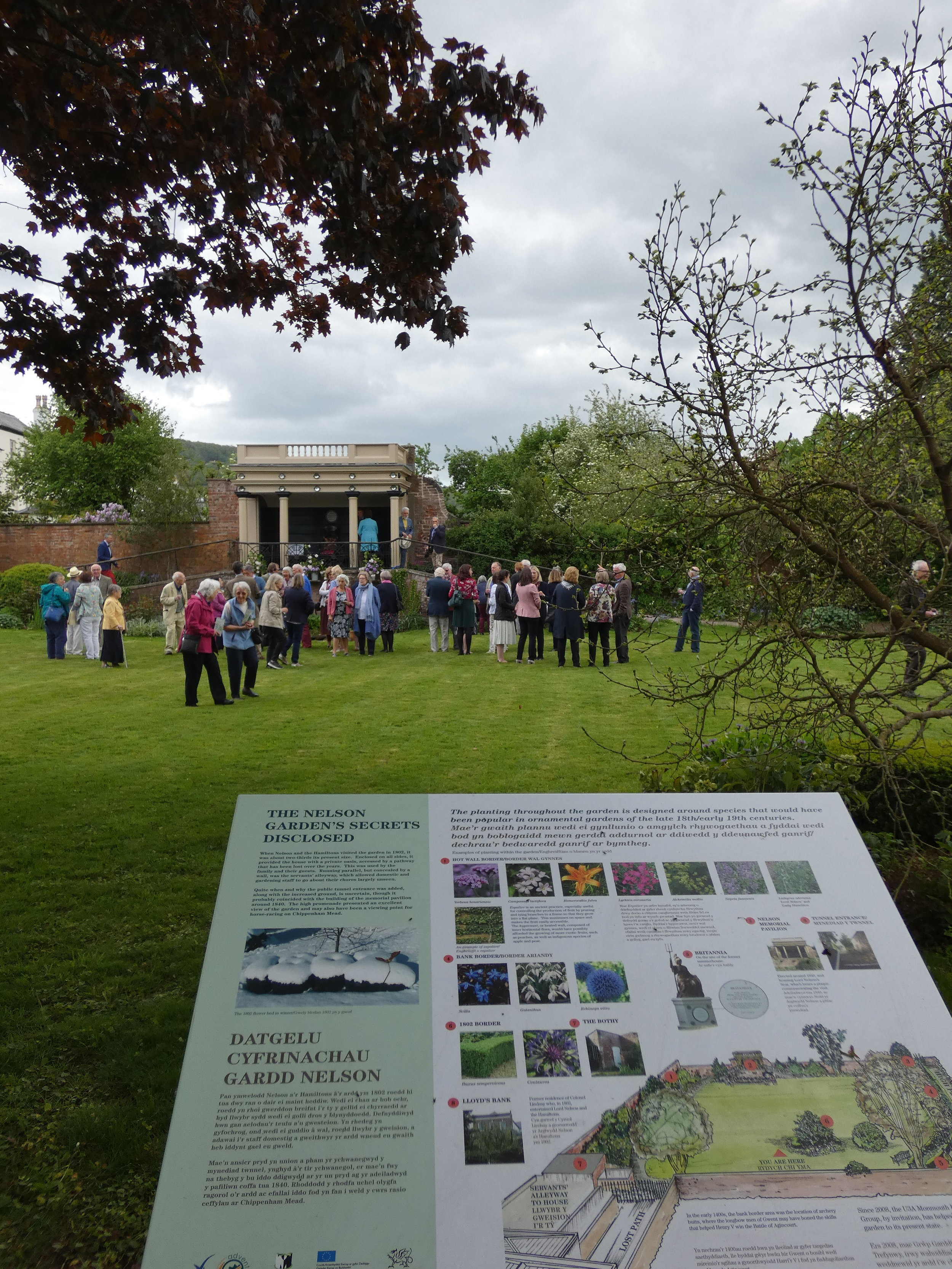Guests milling in the Nelson Garden behind one of the Interpretation panels we have produced for the Trust.