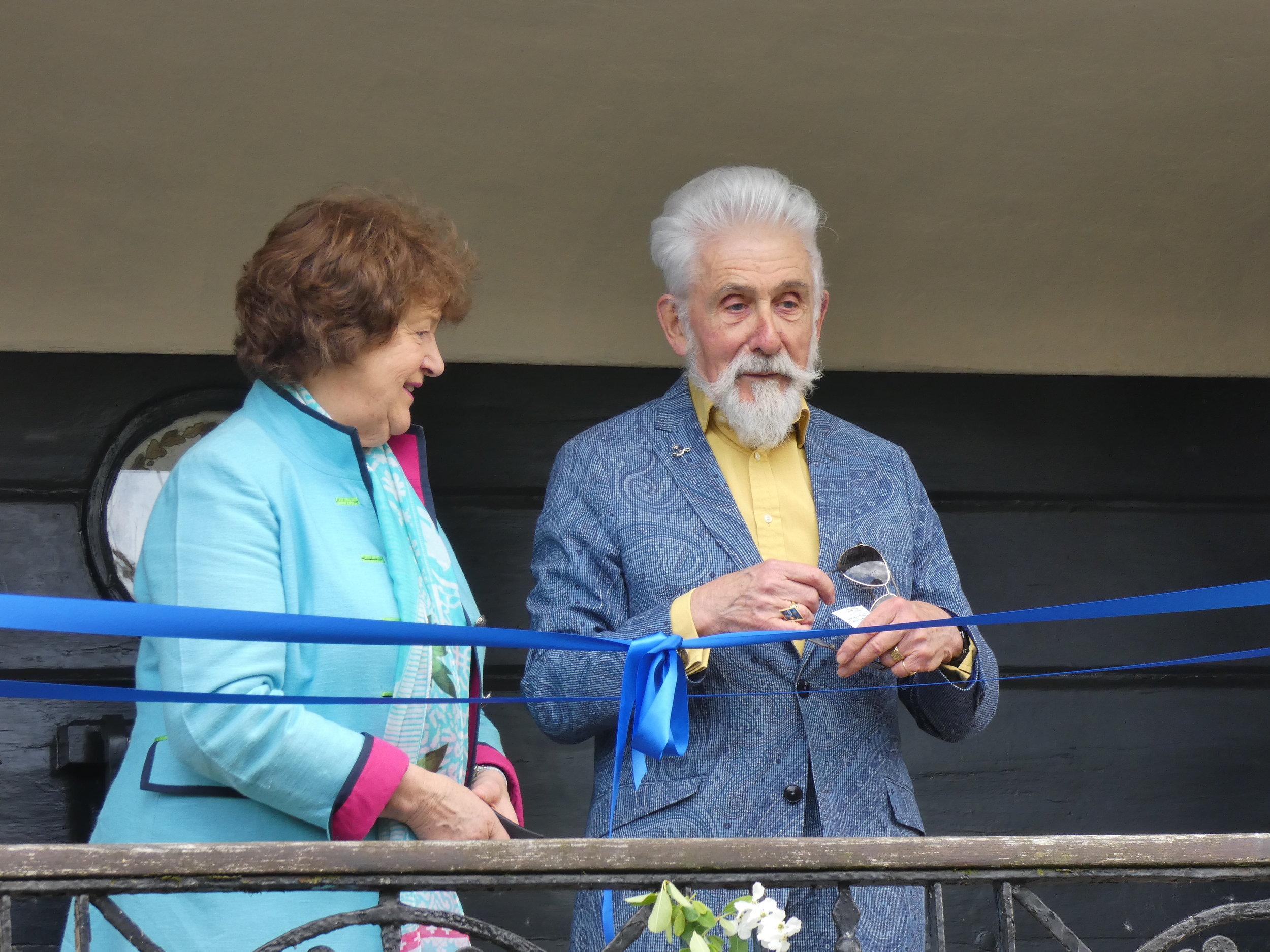 Sir Roy Strong getting ready to cut the ribbon with Helena Gerrish, Chairman of the Nelson Garden Preservation Trust.