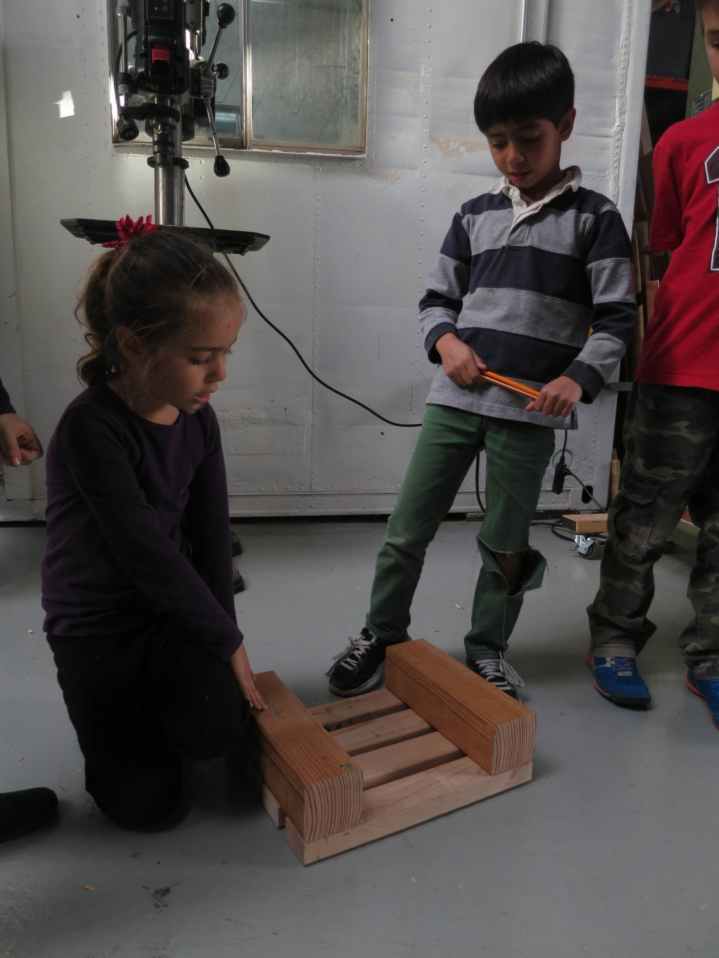 Natalia and Anand get some inspiration from flipping over a built stool used in the shop.