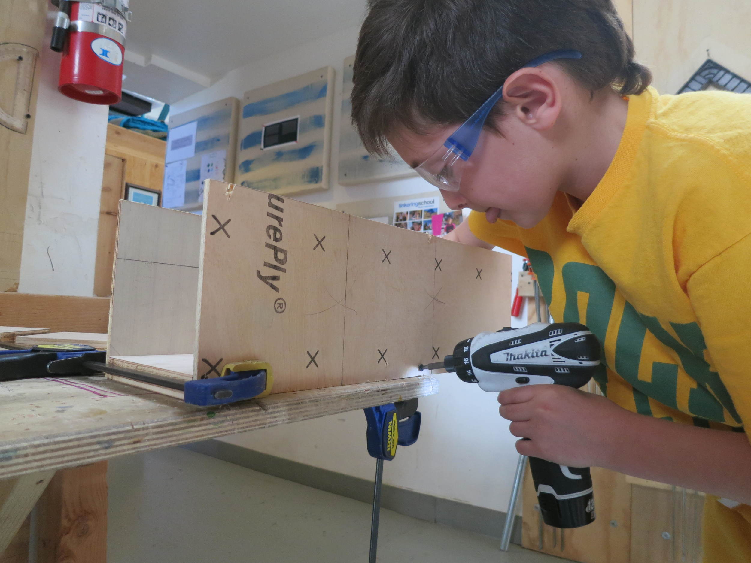 Nico works on completing the container to house the coil dispenser