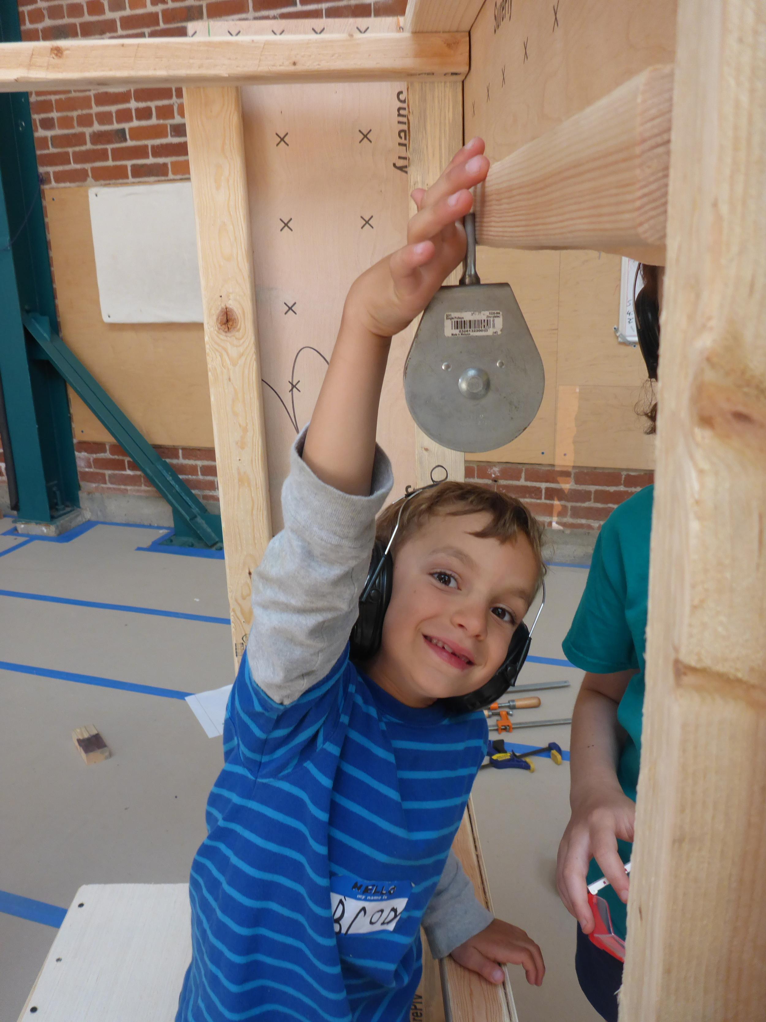 Brody demonstrates where the pulley on the toll booth gate liftershould be installed!