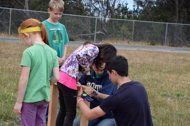 Bridget, Leo, Allison, Anya, and Cameron clamp and screw.