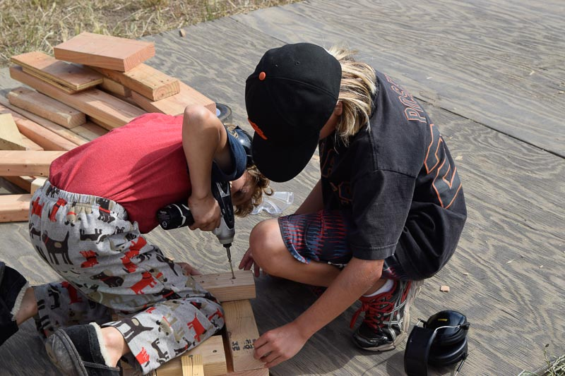 Winter and Sarah work on a corner of their structure.