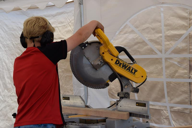Ryker cuts an angle with the chopsaw