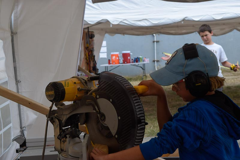 Kelly cuts an angle on the chopsaw.