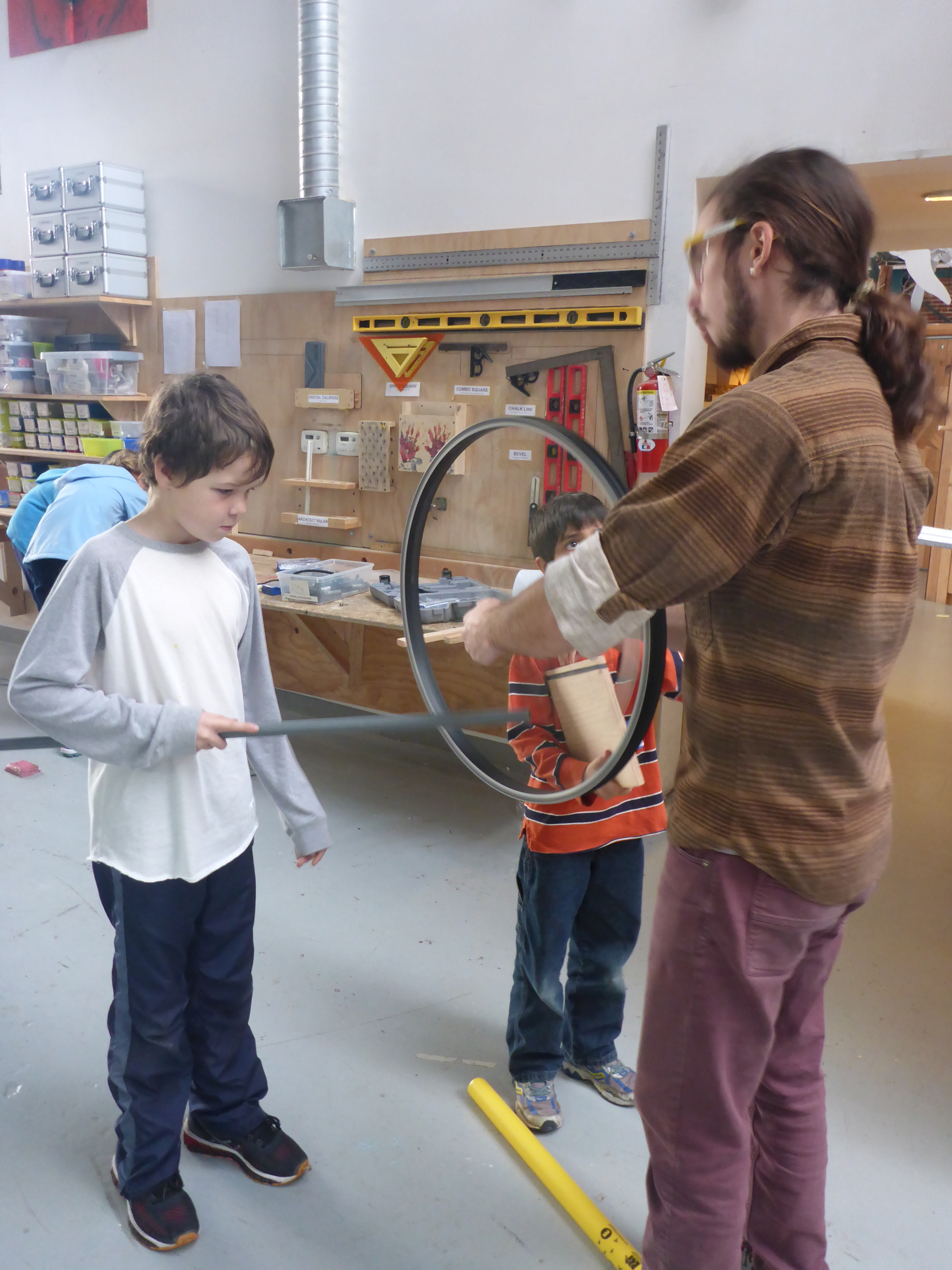 """Playing"" the spokes of an old bicycle wheel."