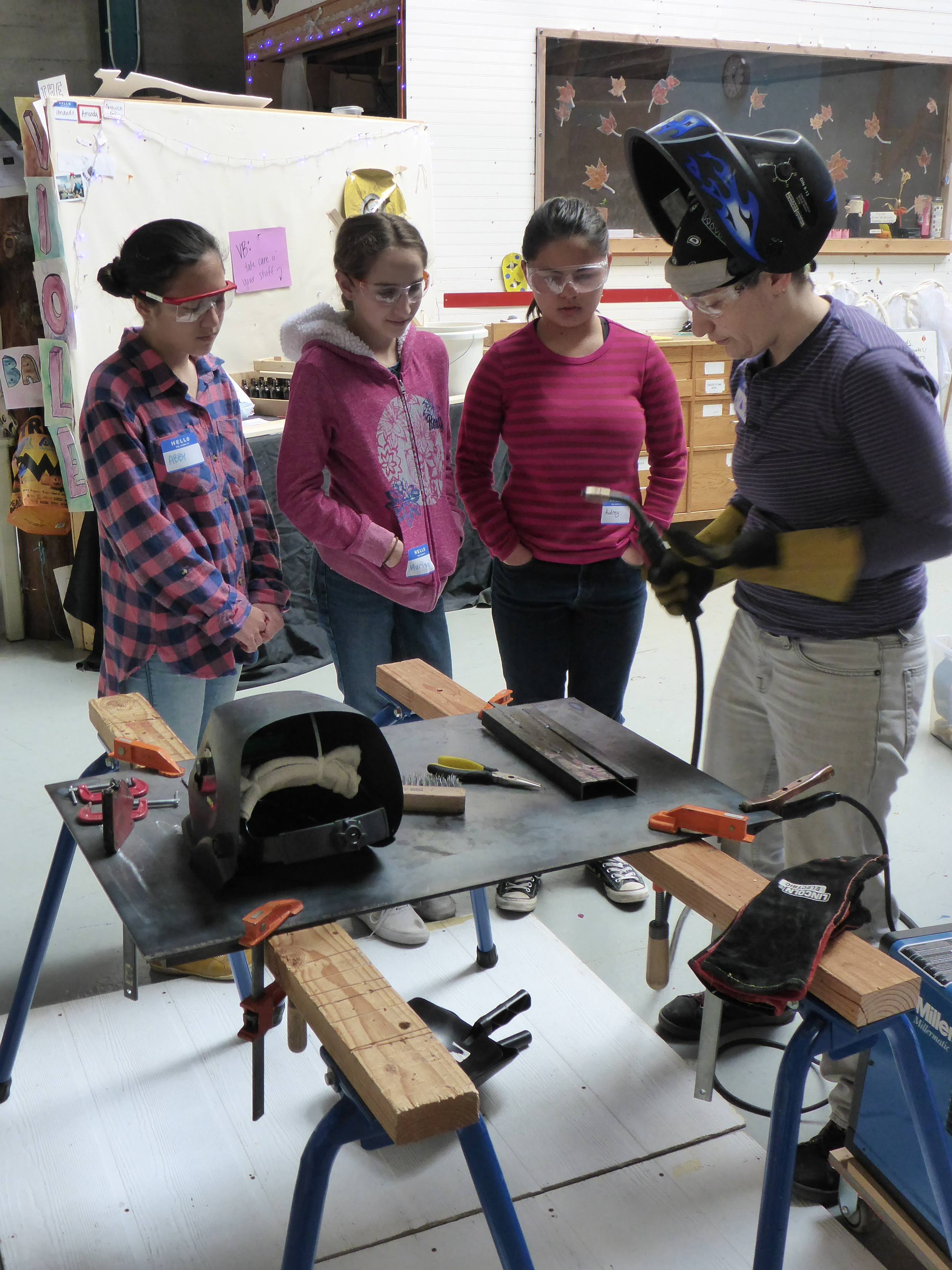Abby, Marisol, Audrey and Amanda get ready for their first times welding.