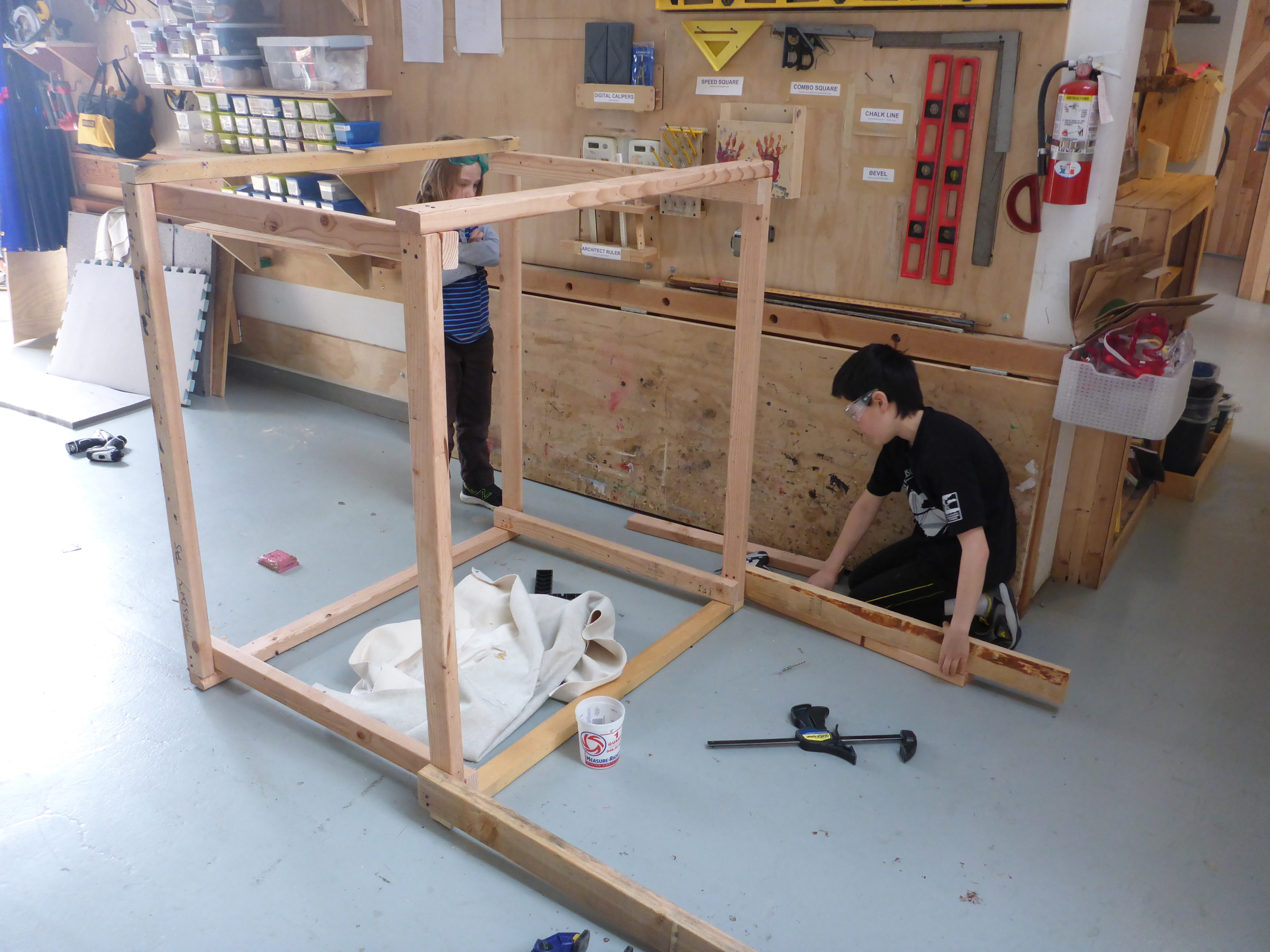 Ayden and Eli finish framing the Fruit Stand.