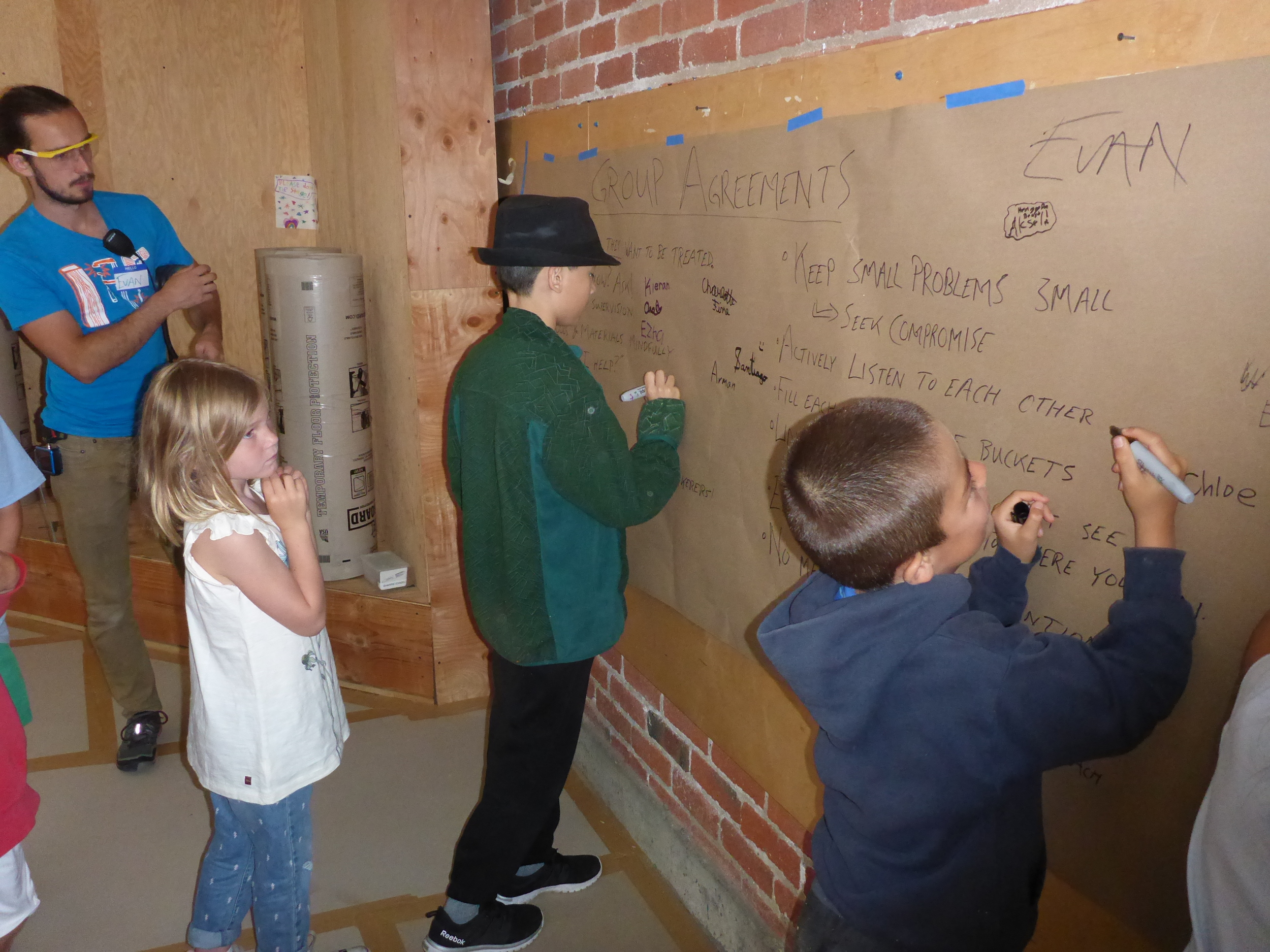Tinkerers signing their names to the group agreement