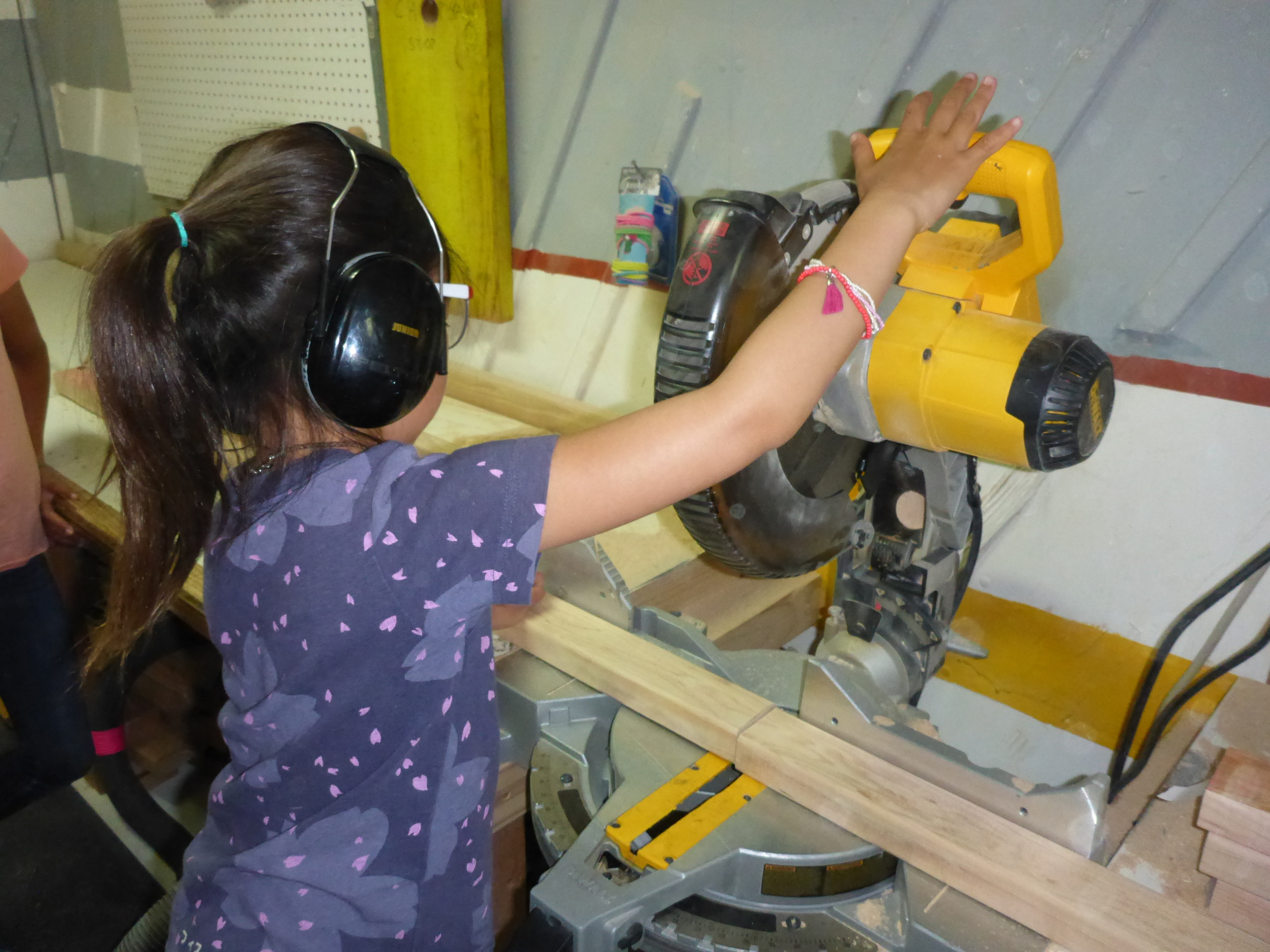 Tinkerers learning to use the chop saw