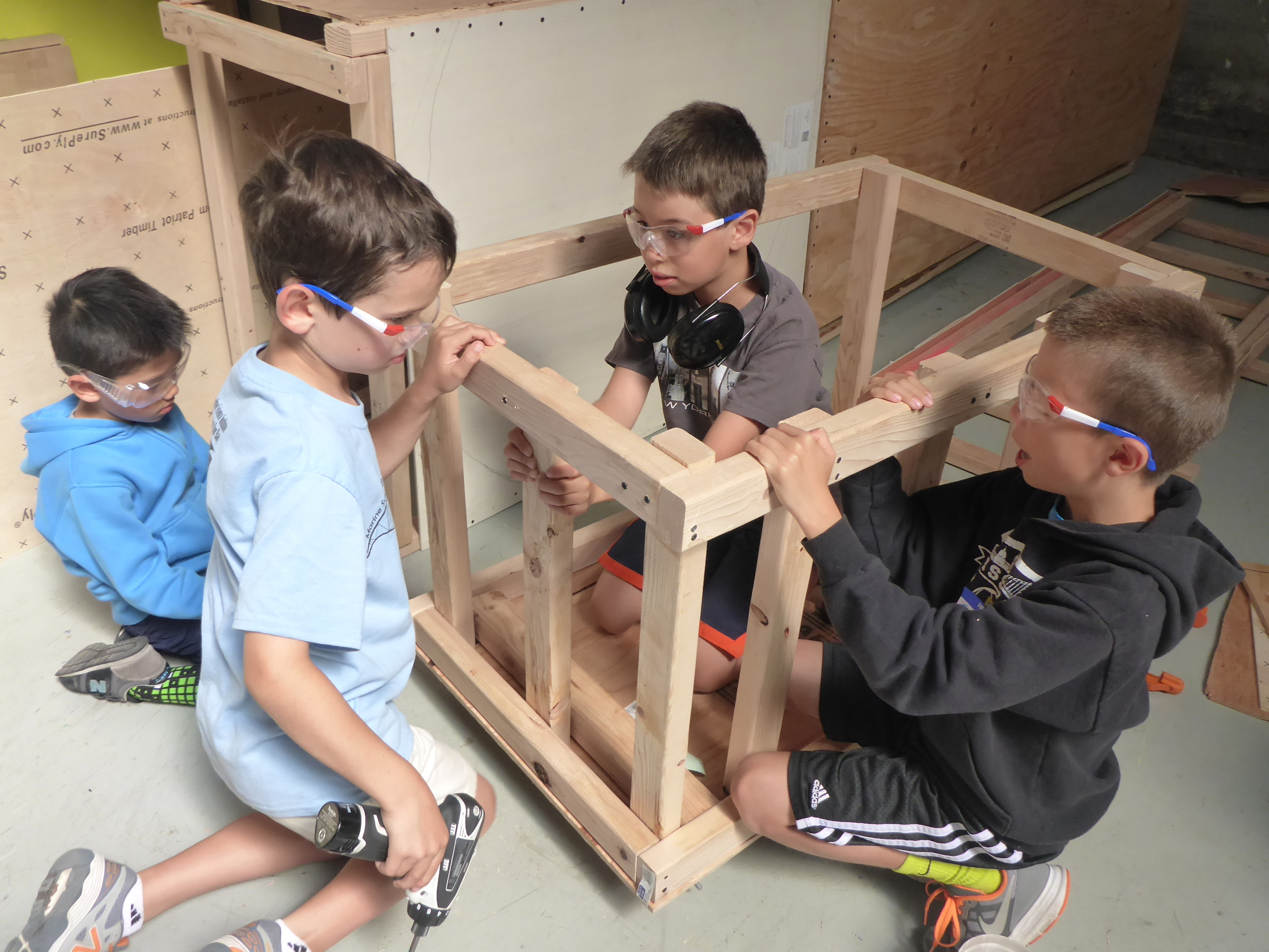 Tinkerers collaborating as they build