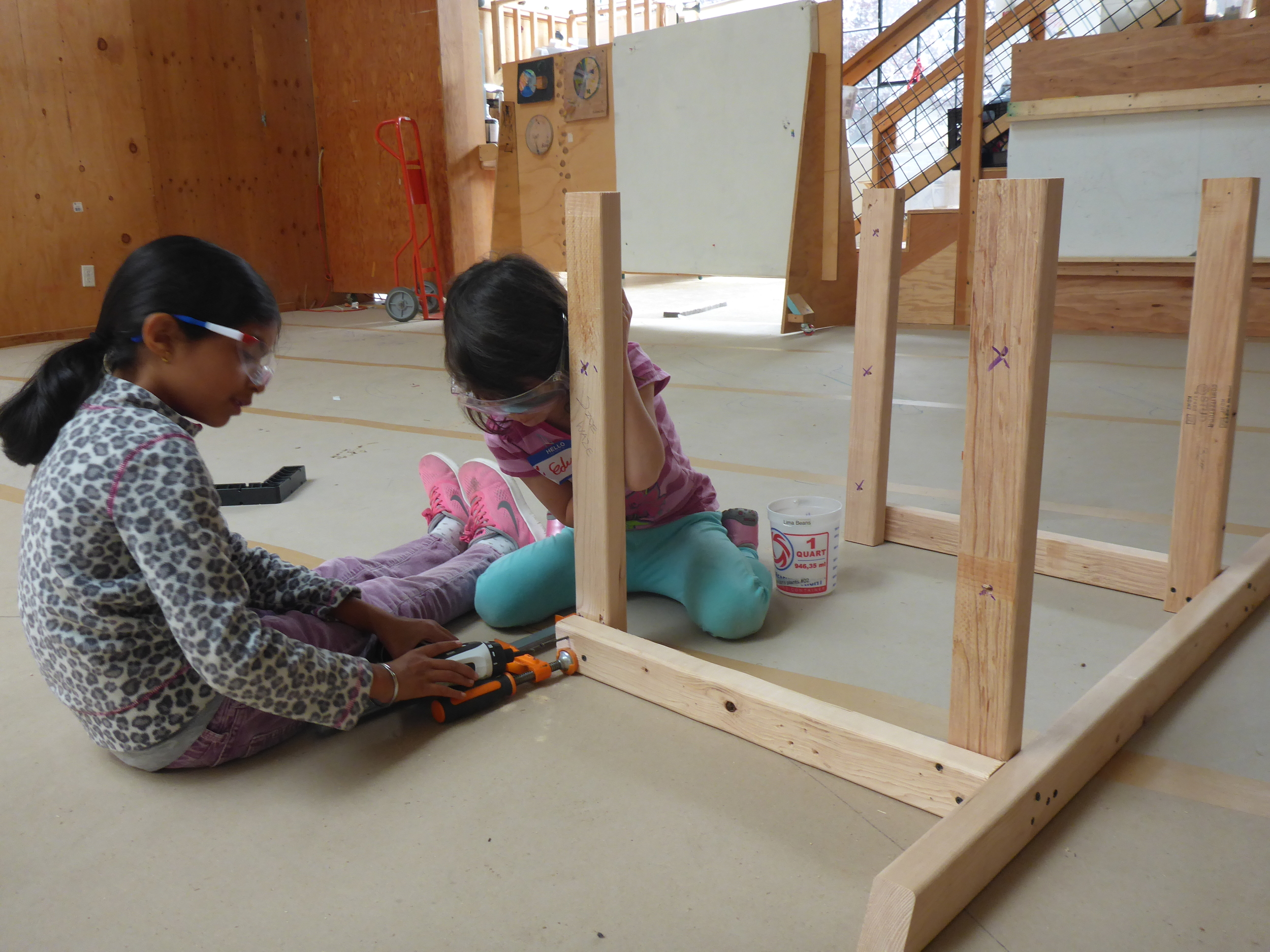 Sophia and Eden working together to create a frame for the Mermaid Lagoon.