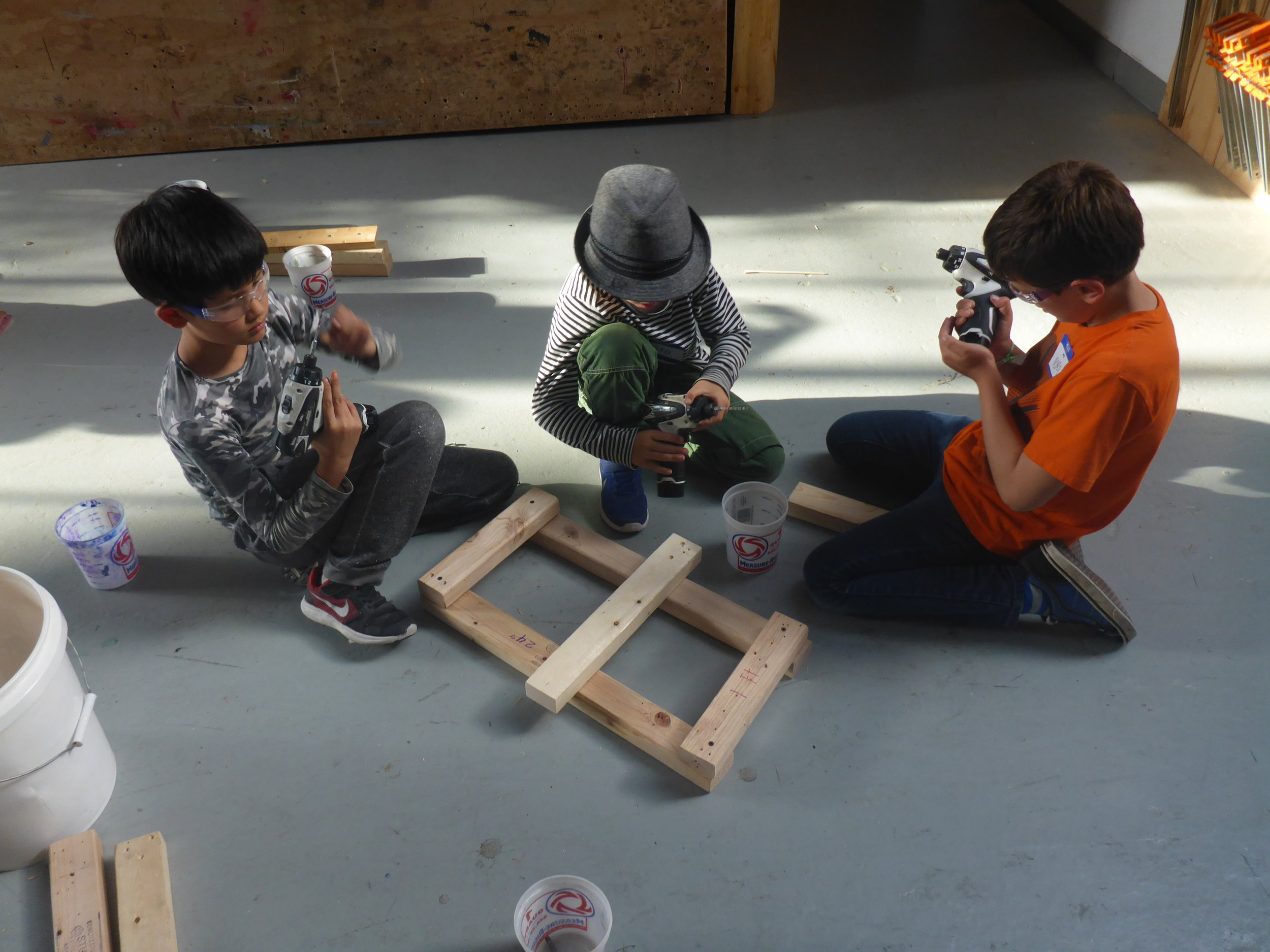 Jaro, Munir and Nolan go above and beyond the simple task of building a quadrilateral and make a super-strong ladder.  They're learning that its much easier to drill as a team.