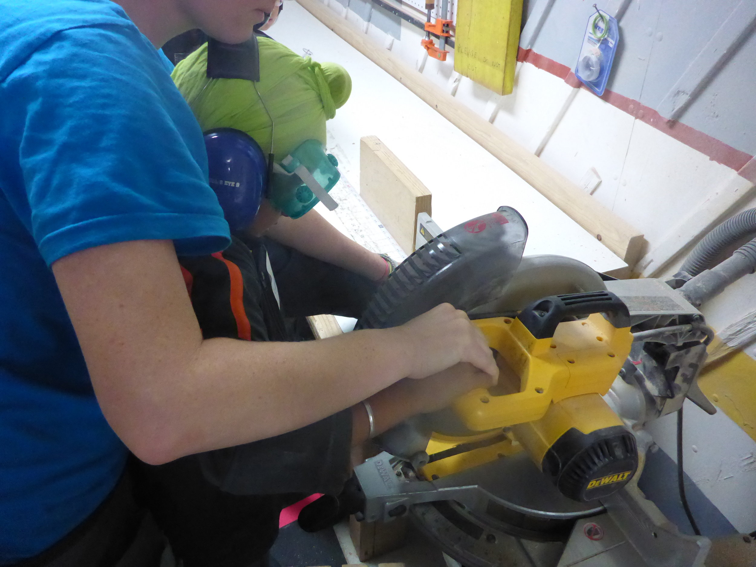 Lindsay helps Gurneet get to know what will become his favorite tool of the day - the Chopsaw!
