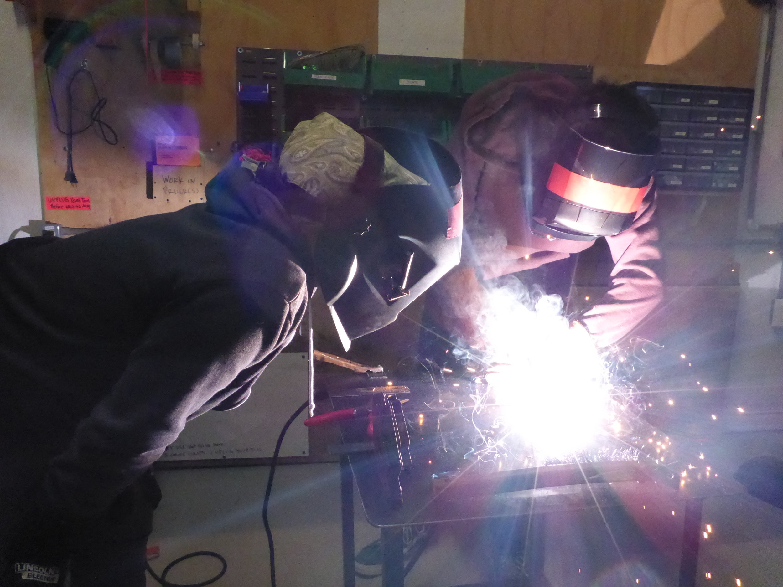 Lee getting started welding on his practice plate. I love the range of ages in welding workshops too. Something this hard is a great equalizer; both the 8 year olds and the 14 year olds will have great advice to give each other.