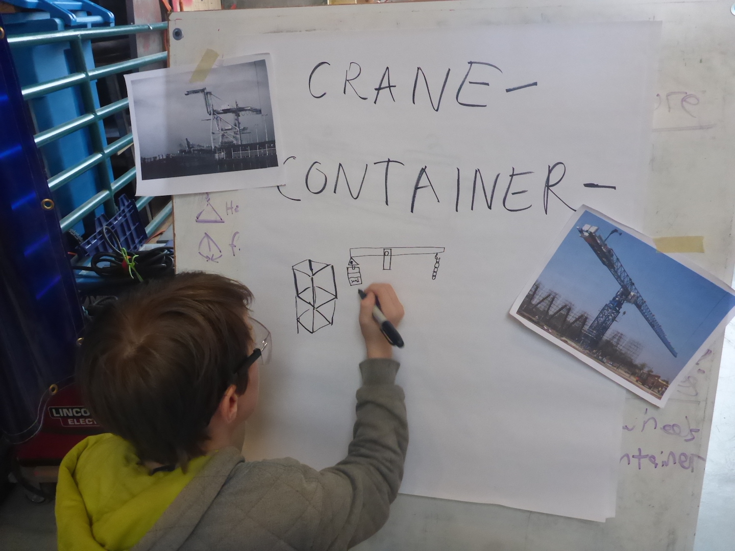 Leo draws his ideas for a mechanism to keep the crane balanced