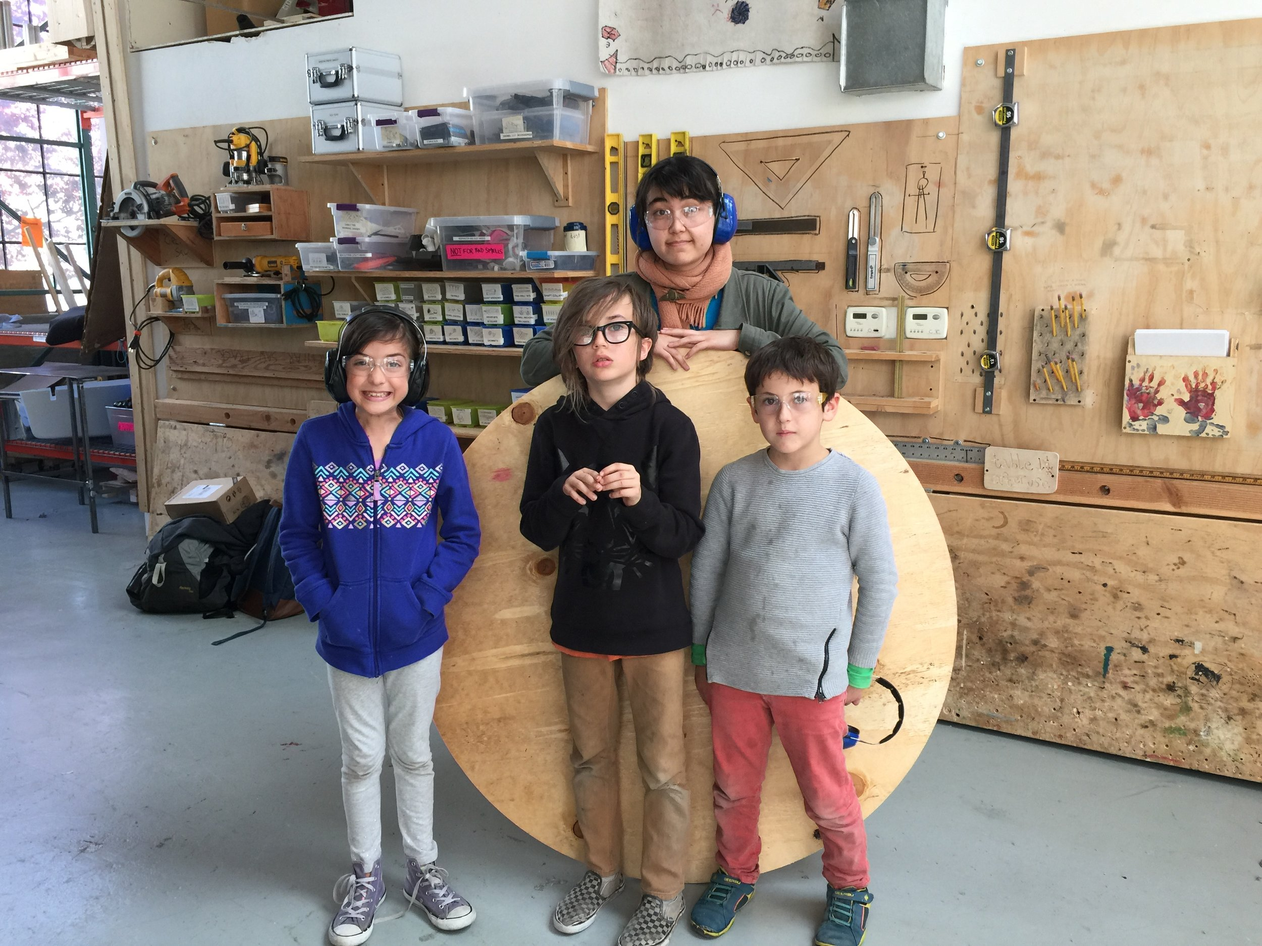 Zoe, Henry, Anton and Sayuri show off the perfect wheel they just cut out!