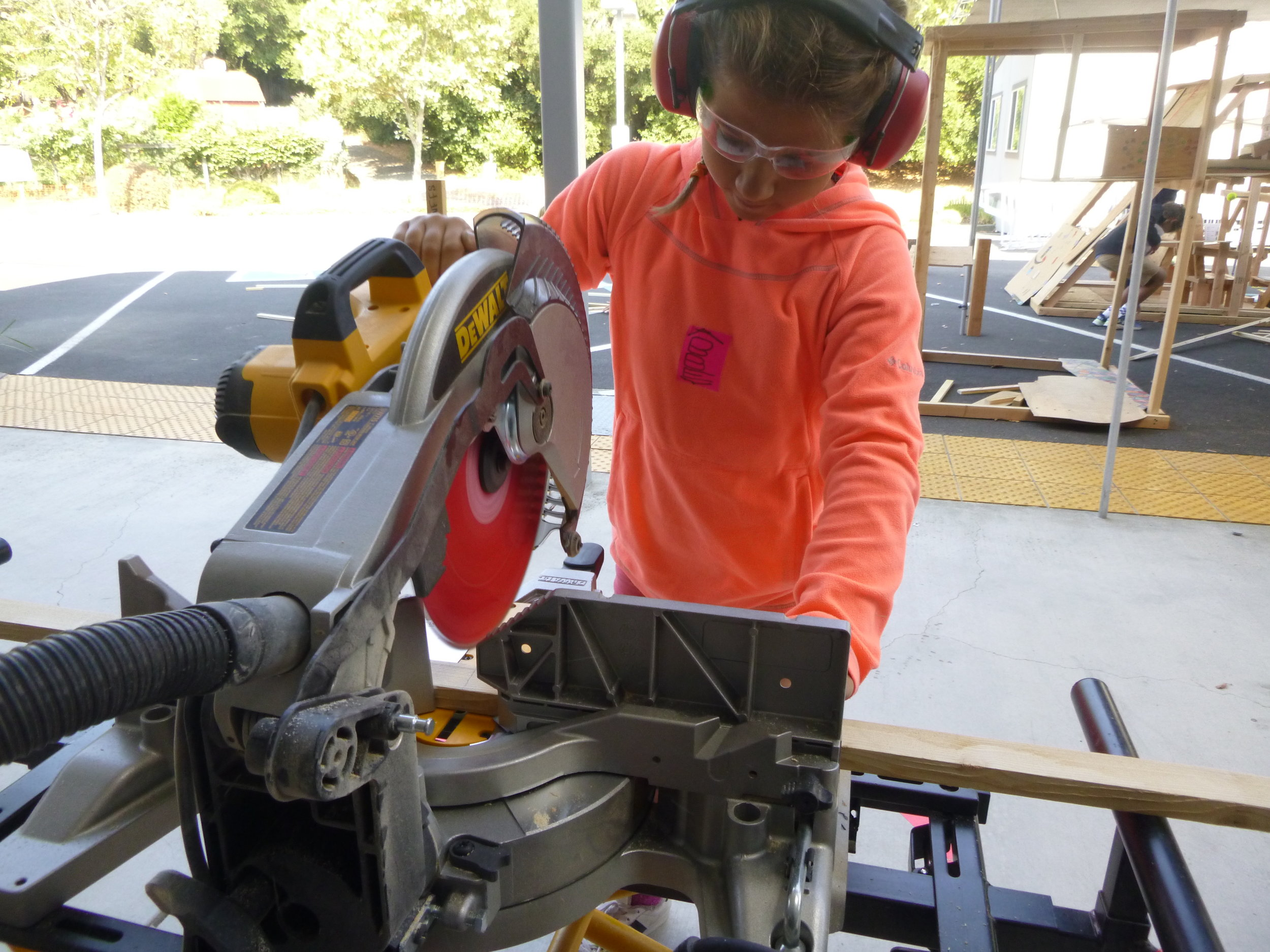 Abbey sawing away. The kids got a LOT of practice this week - we used a ton of wood!