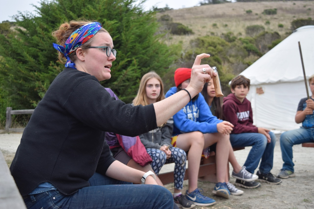 Kaitlyn presents how to use a knife safely to campers.