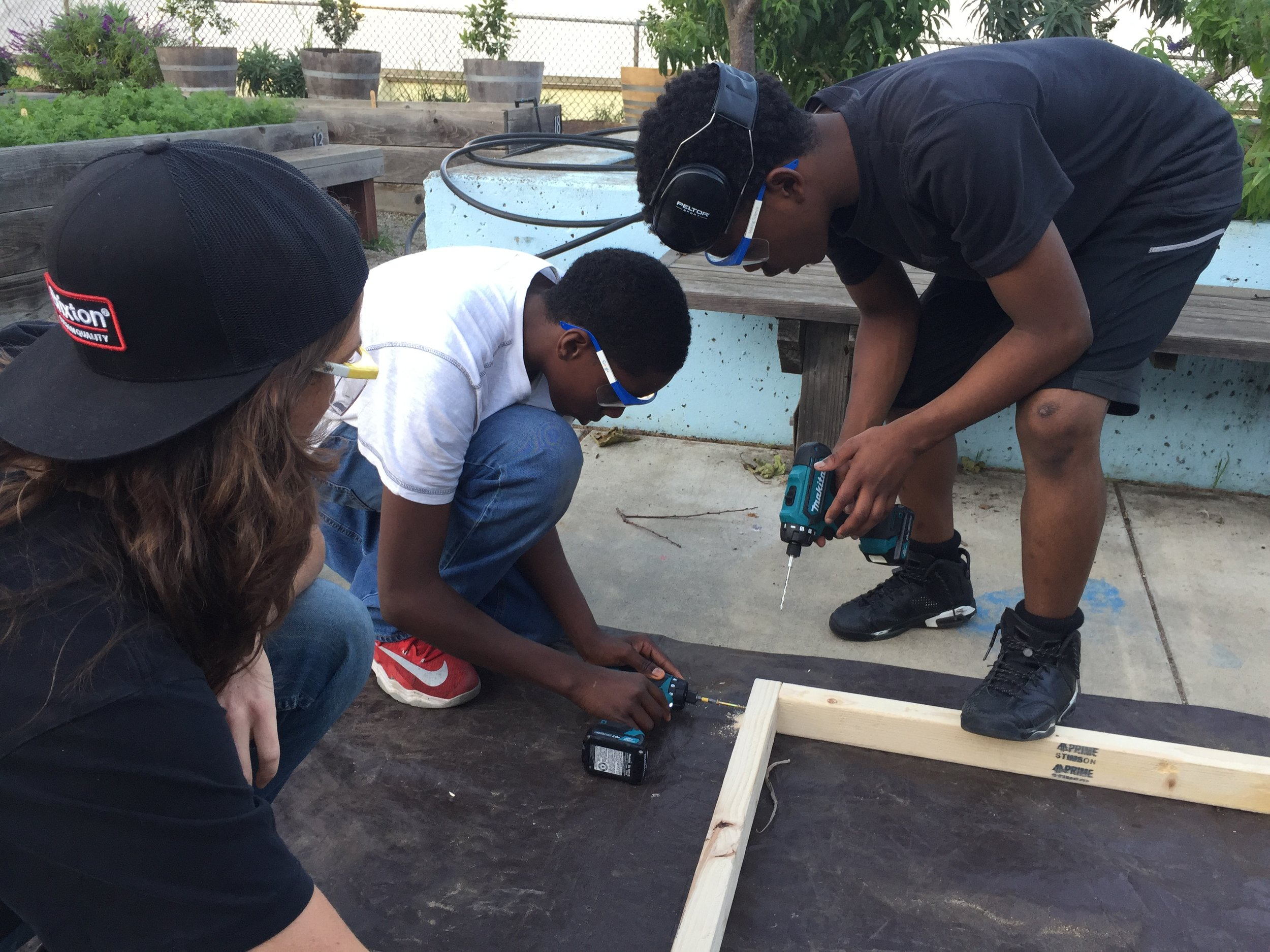 Malieke and Edward found they could be super productive working together by taking turns drilling and screwing.