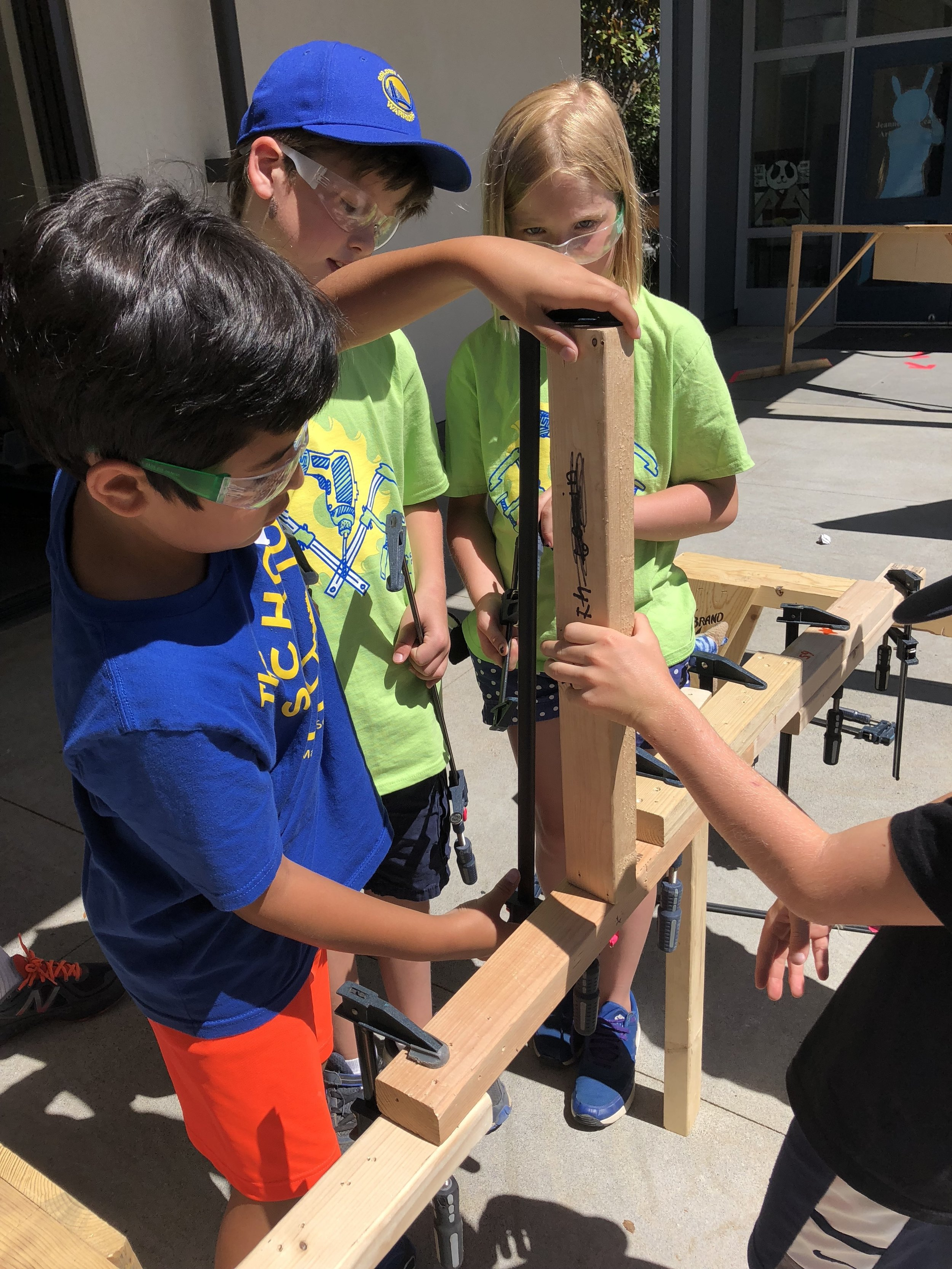 Building a bridge using clamps.