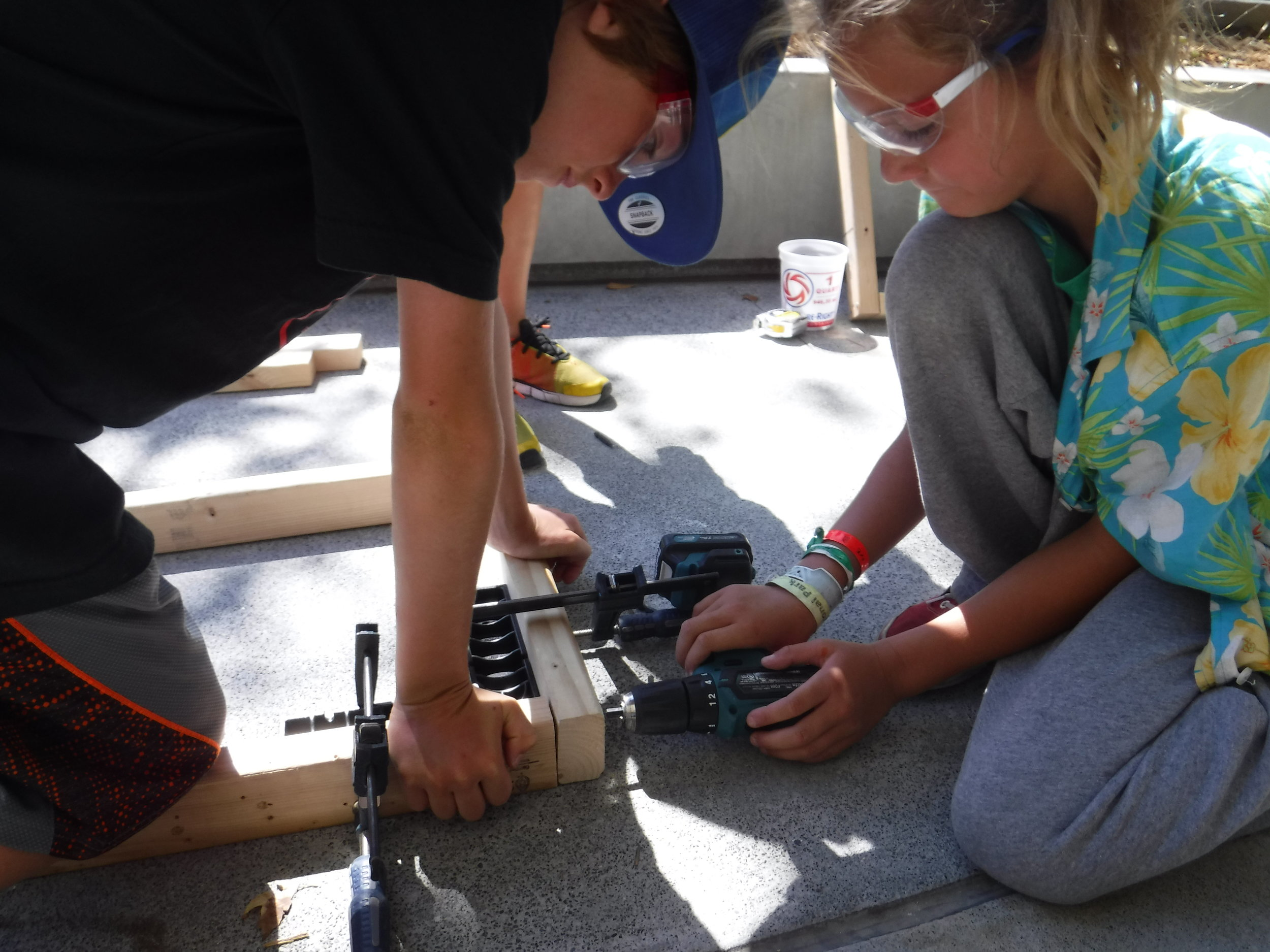 Assembly square + clamp + a partner to hold the wood = successful drilling.