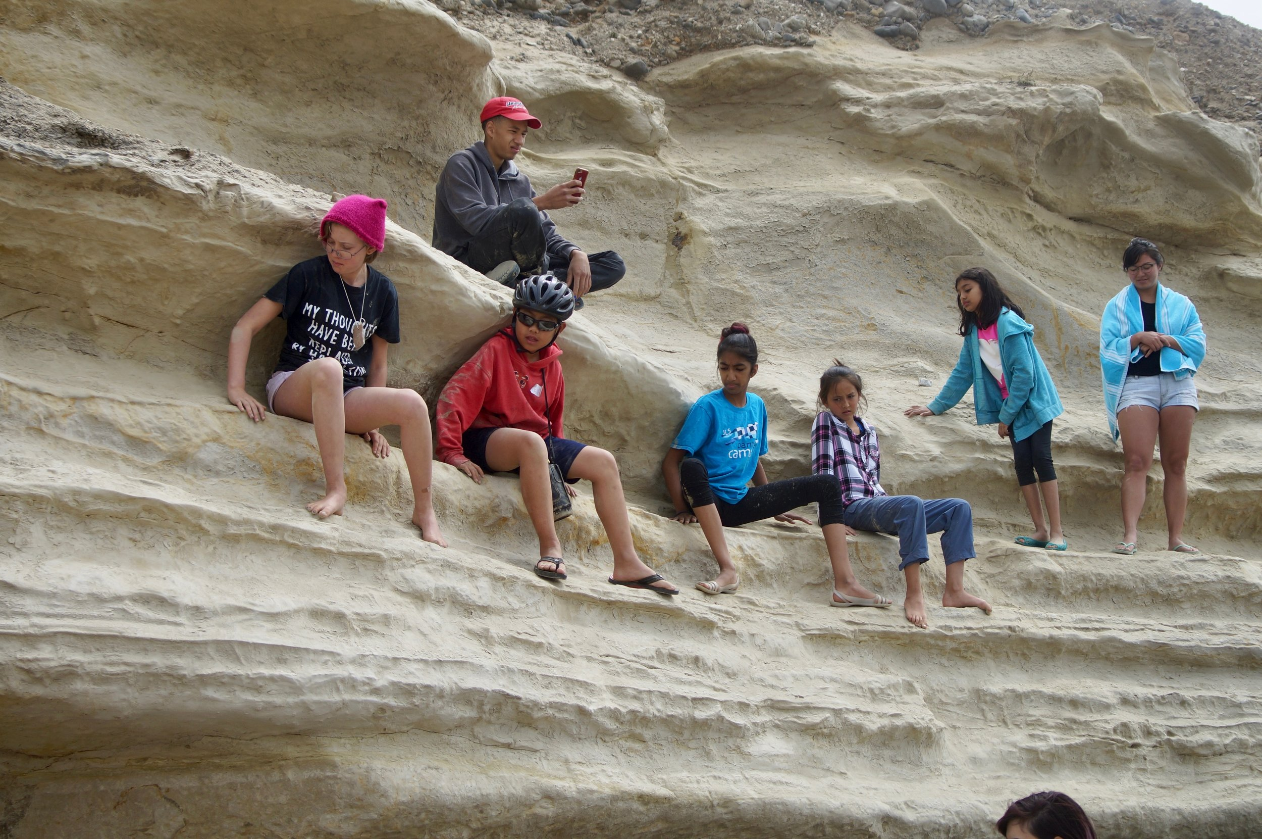 The campers try to navigate across the treacherous cliff and make their way towards the beach.