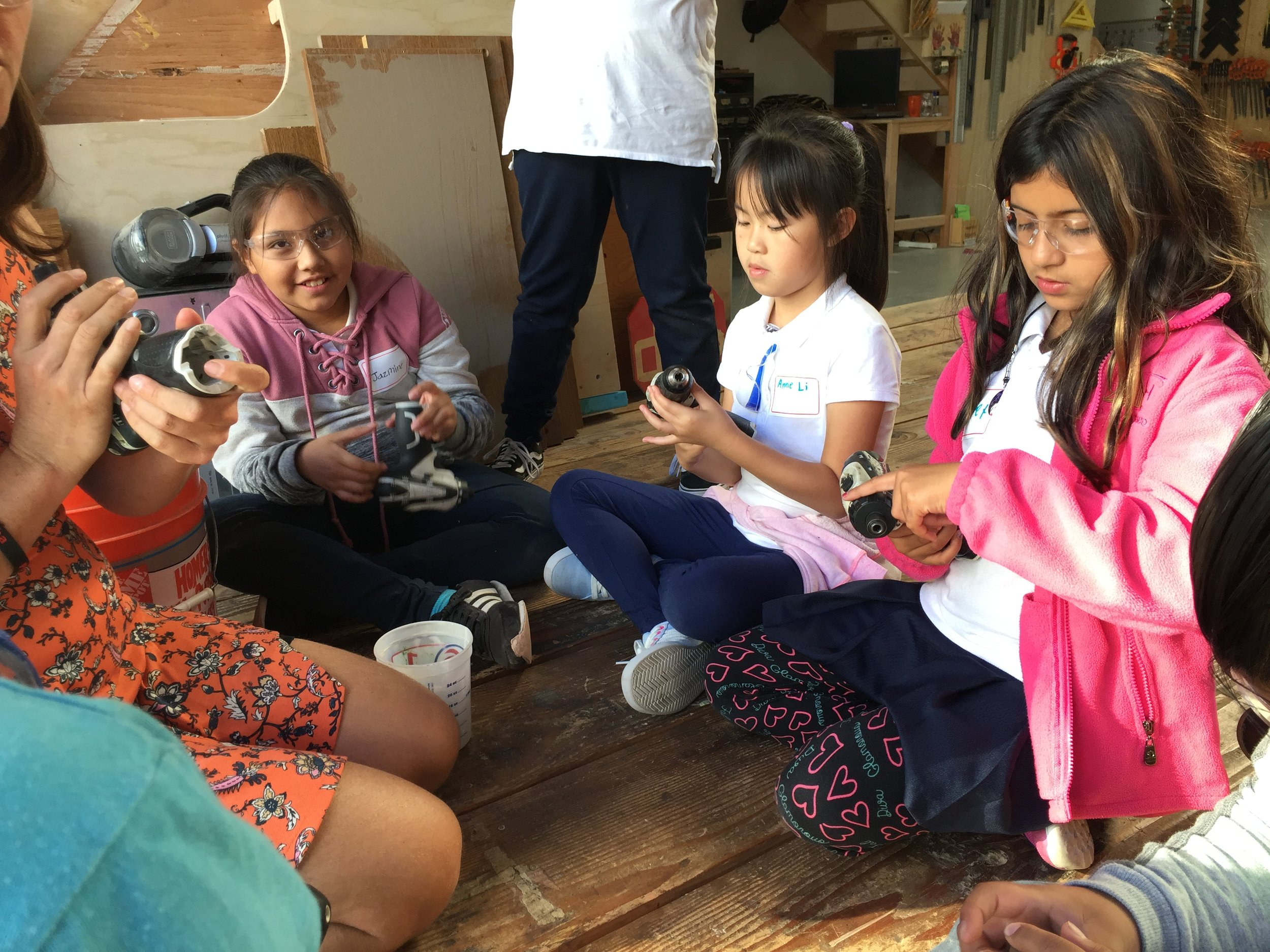 The kids inspected their drills first without batteries. They learned what the many buttons do as well as how to insert and remove drill and screw bits.