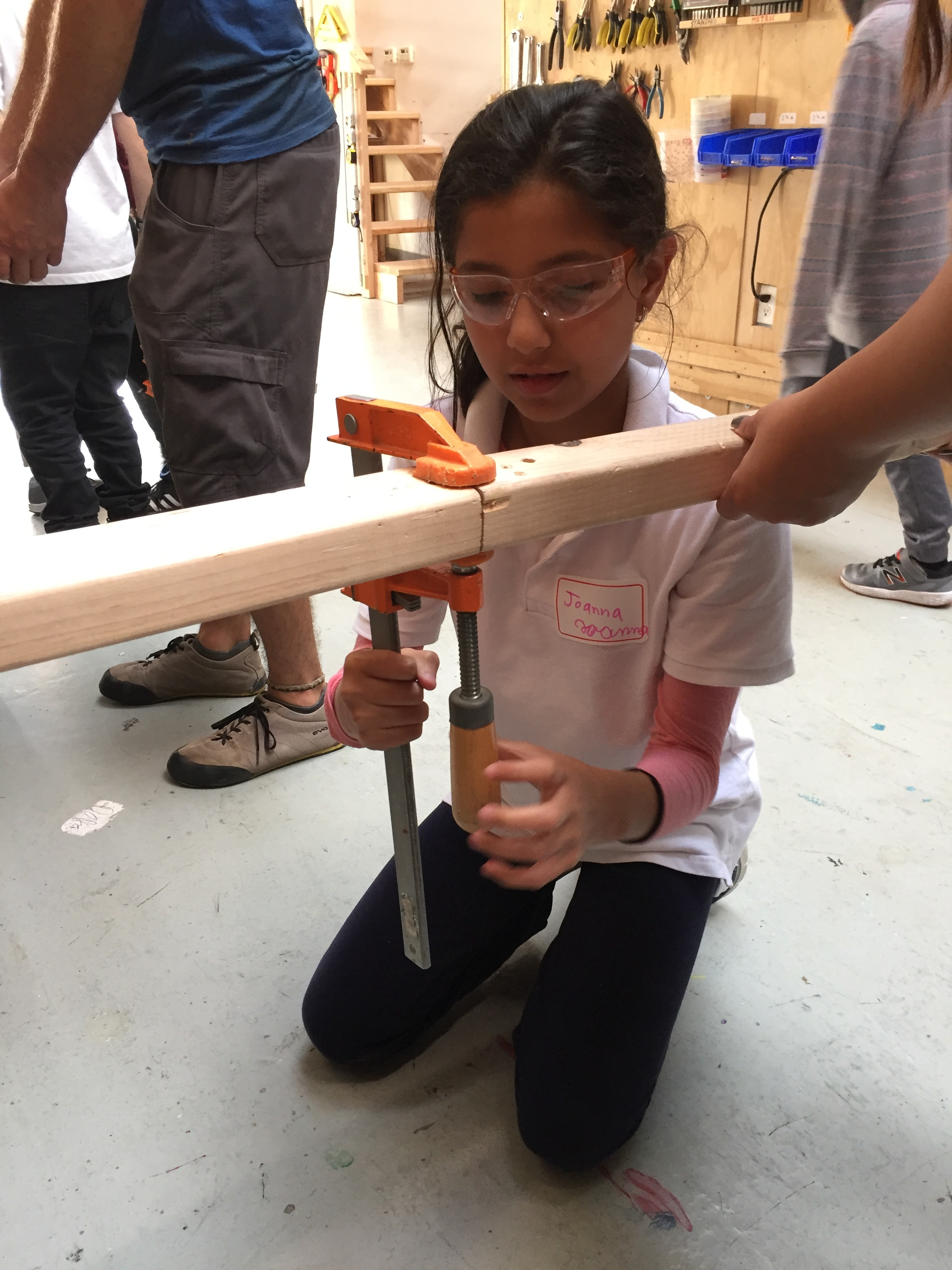 Joanna tested different ways to clamp two pieces of wood together. End to end, the pieces fell apart easily.