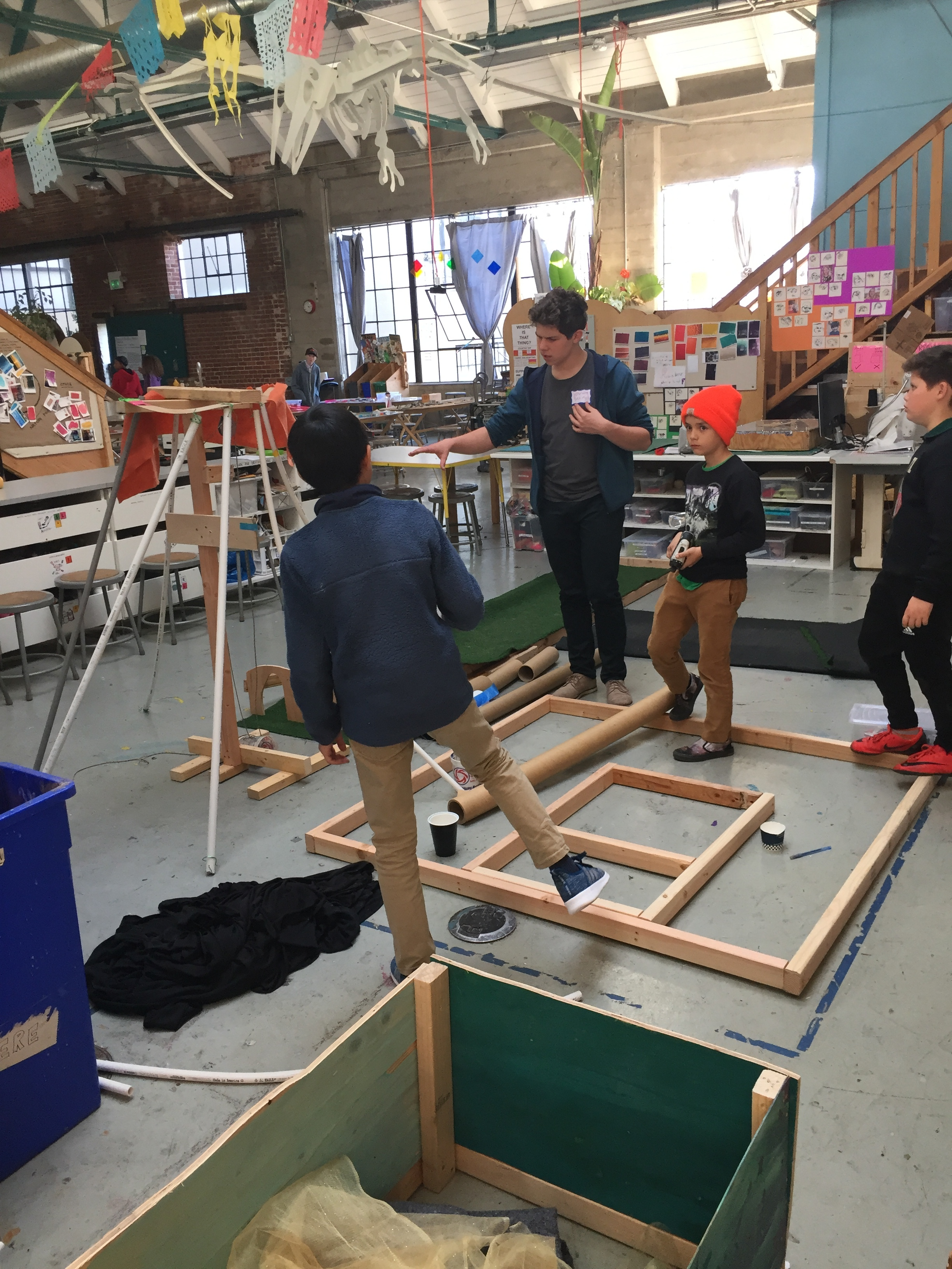 Owen and the Volcano team work on constructing the putting green.